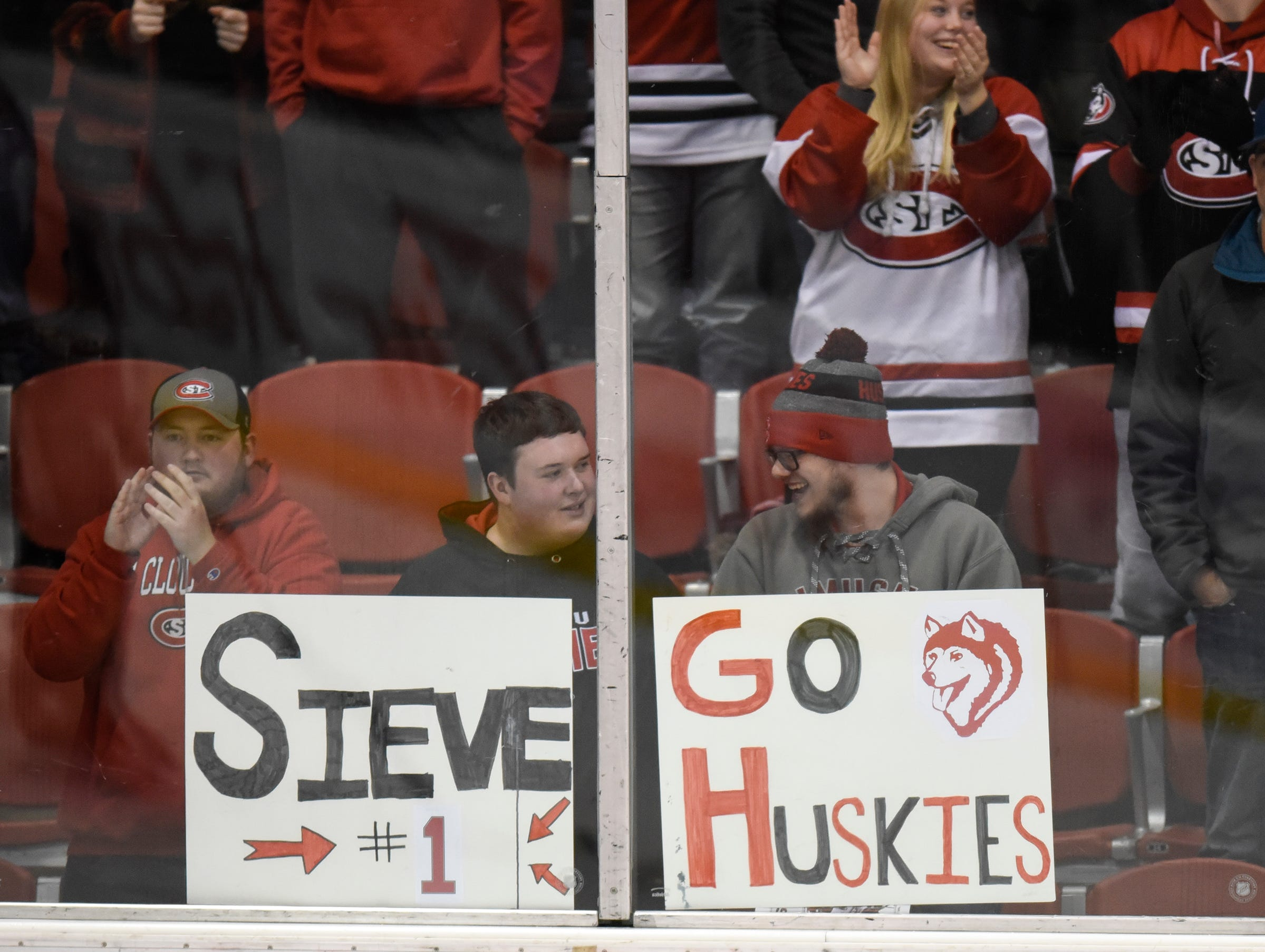 St. Cloud State fans hold signs during the first period of the Saturday, Nov. 10, game against the University of Denver at the Herb Brooks National Hockey Center in St. Cloud.