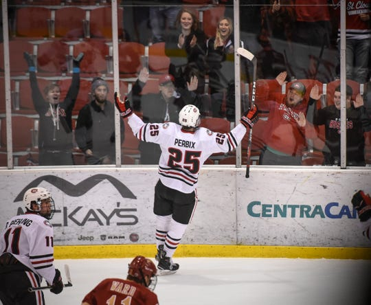 St. Cloud State's Nick Perbix celebrates his first collegiate goal during the first period of the Saturday, Nov. 10, game against the University of Denver at the Herb Brooks National Hockey Center in St. Cloud.