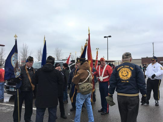 Veterans gather and chat before the Veterans Day Parade, Nov. 11, 2018 in St. Cloud.