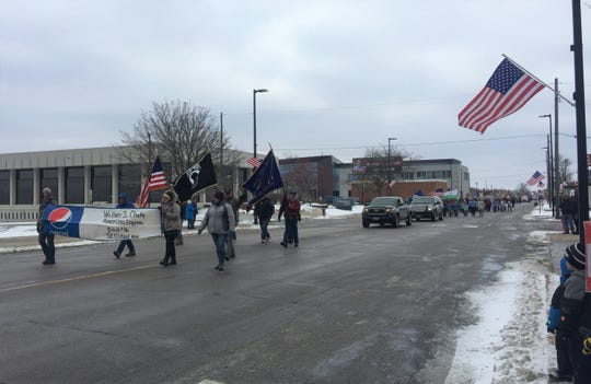 Near the beginning of the St. Cloud Veterans Day Parade downtown on Sunday.