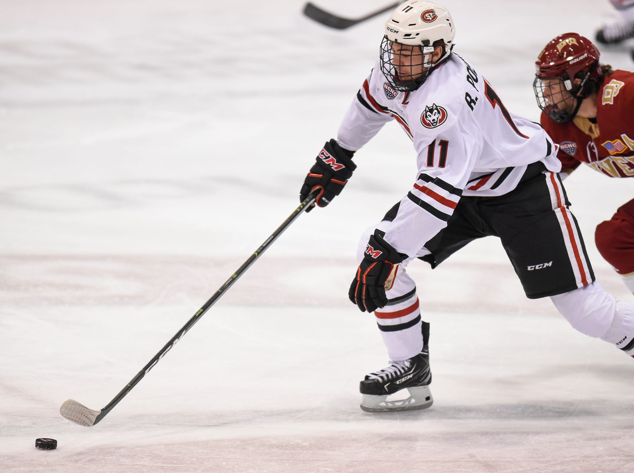 St. Cloud State's Ryan Poehling skates with the puck during the first period of the Saturday, Nov. 10, game against the University of Denver at the Herb Brooks National Hockey Center in St. Cloud.