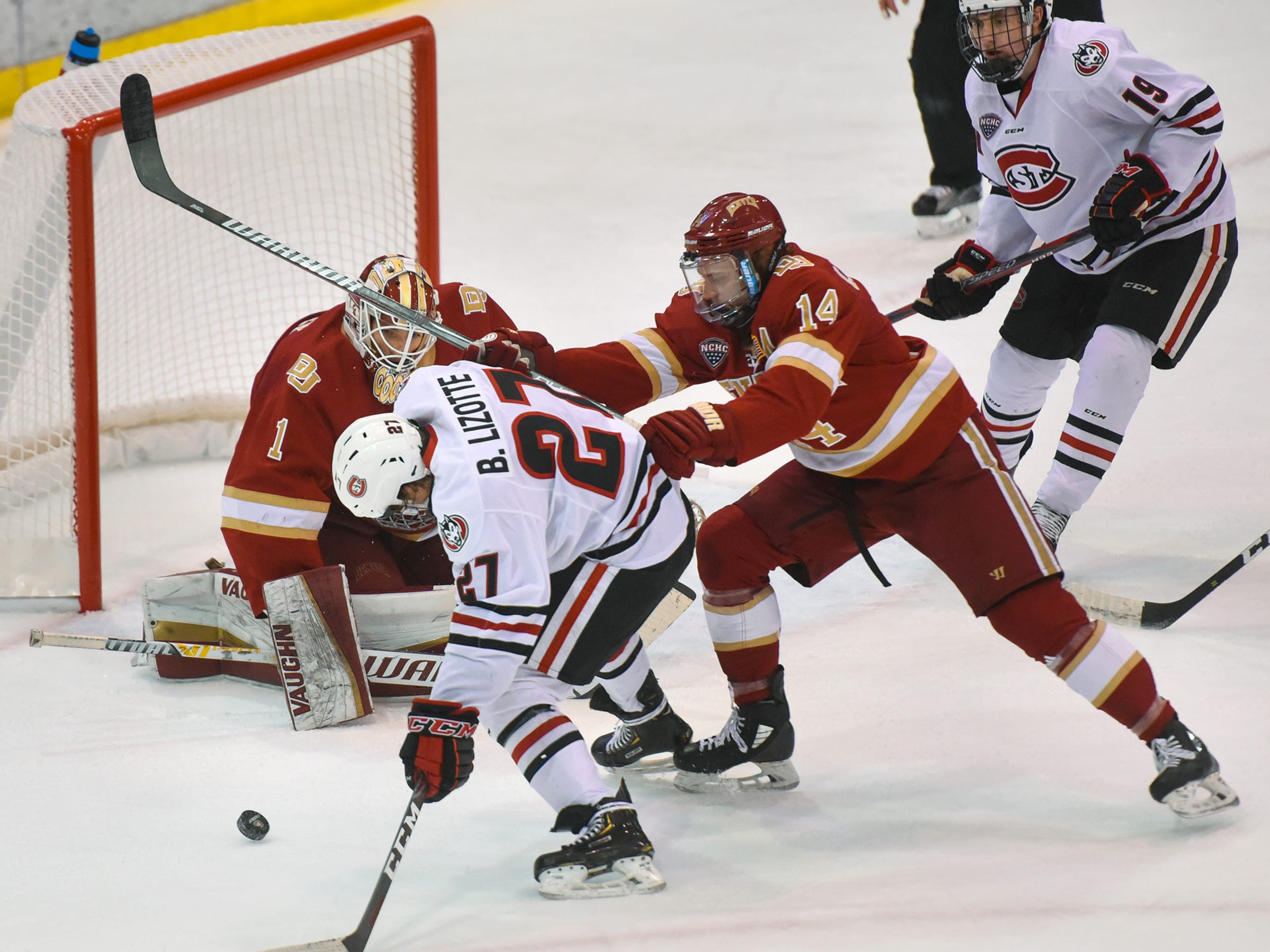 St. Cloud State's Blake Lizotte tries to get a shot on Denver goaltender Devin Cooley during the first period of the Saturday, Nov. 10, game at the Herb Brooks National Hockey Center in St. Cloud.