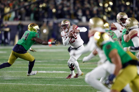 Nov 10, 2018; South Bend, IN, USA; Florida State Seminoles quarterback Deondre Francois (12) scrambles out of the pocket against the Notre Dame Fighting Irish during the first quarter at Notre Dame Stadium. Mandatory Credit: Brian Spurlock-USA TODAY Sports