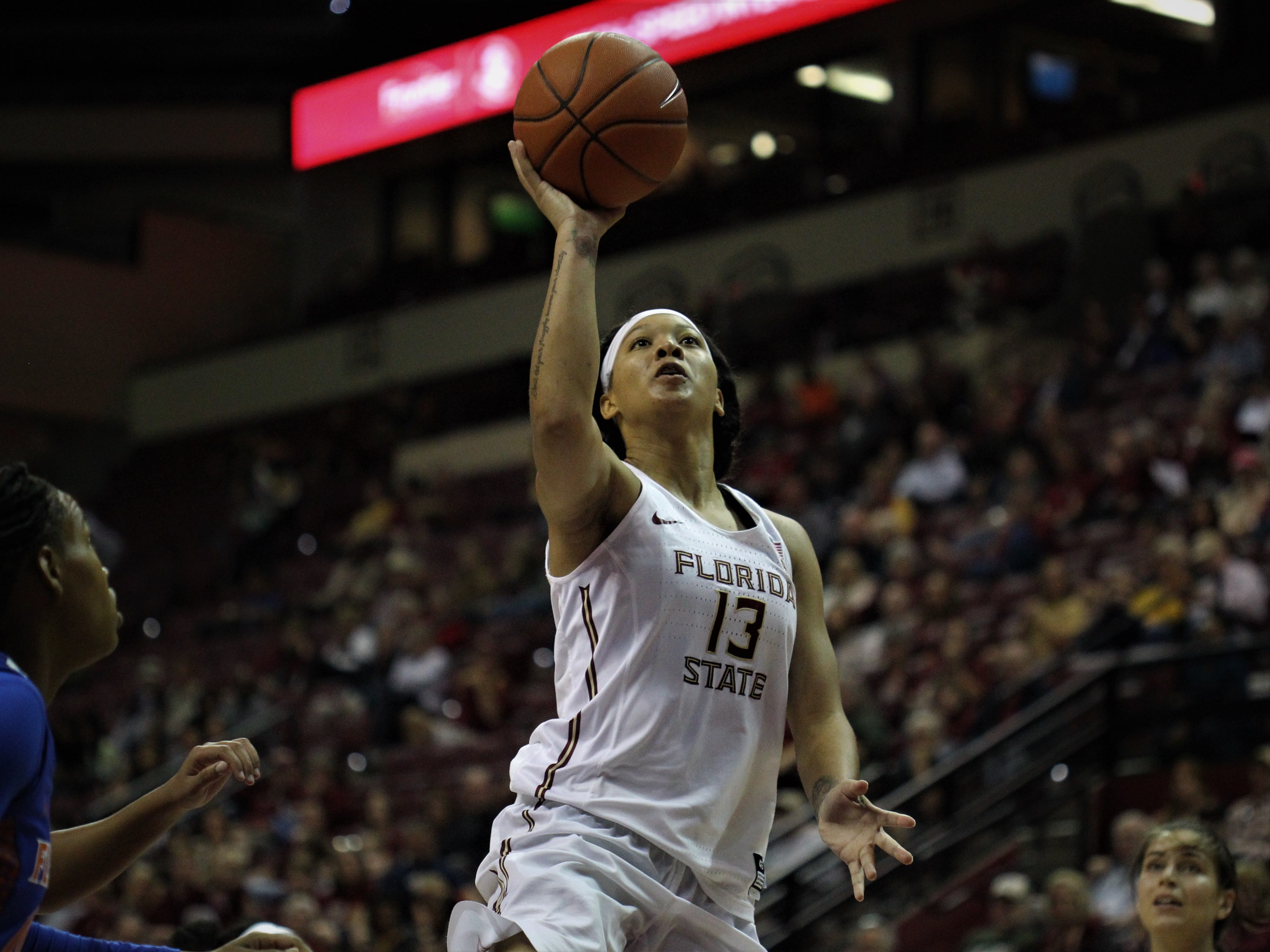 Florida State's Nausia Woolfolk goes up for a layup during the first half of the Seminoles' game against Florida at the Tucker Civic Center on Nov. 11, 2018.