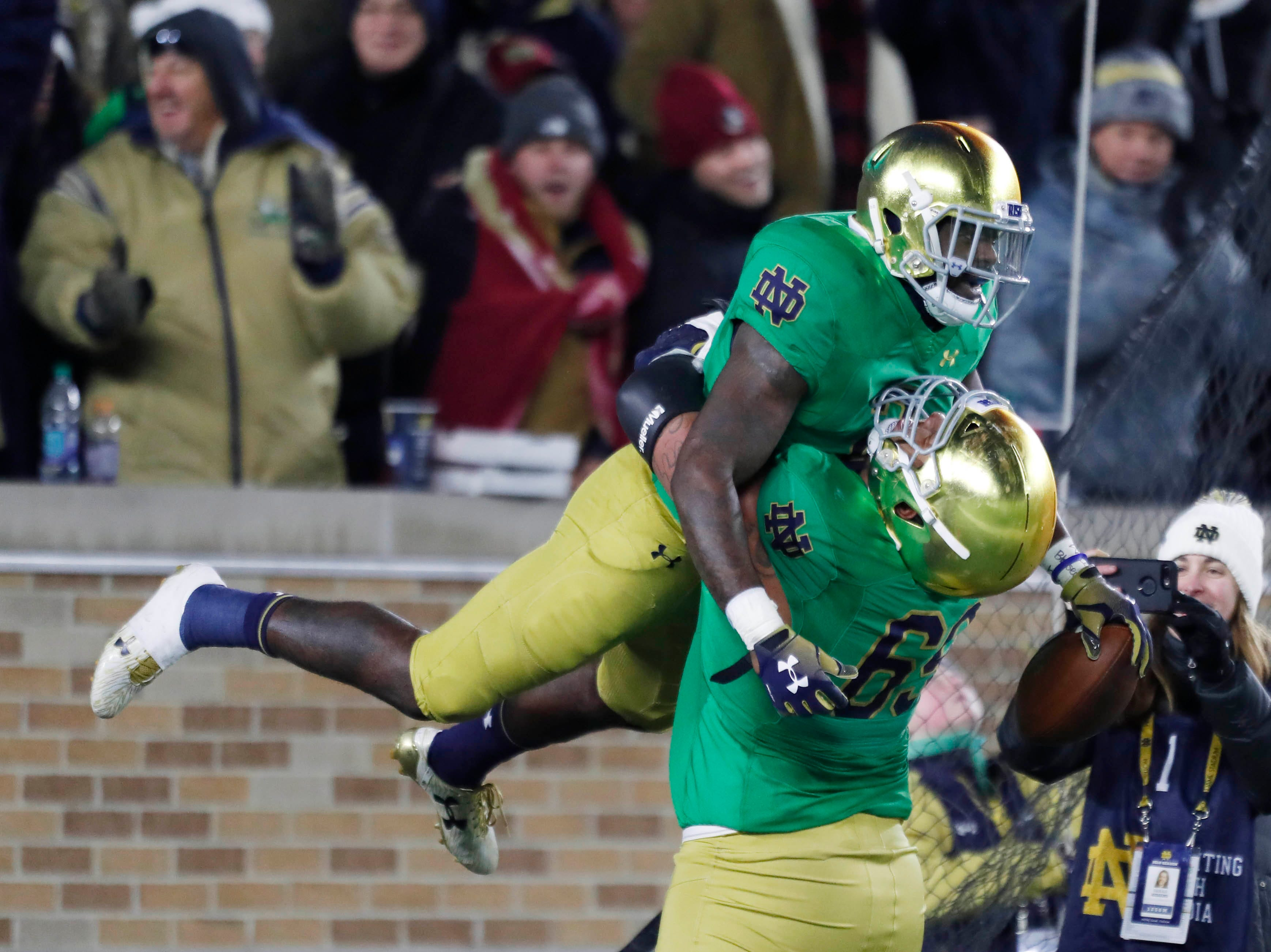 Nov 10, 2018; South Bend, IN, USA; Notre Dame Fighting Irish running back Dexter Williams (2) celebrates with offensive lineman Aaron Banks (69) after scoring on a 58 yard touchdown run against the Florida State Seminoles during the second quarter at Notre Dame Stadium. Mandatory Credit: Brian Spurlock-USA TODAY Sports