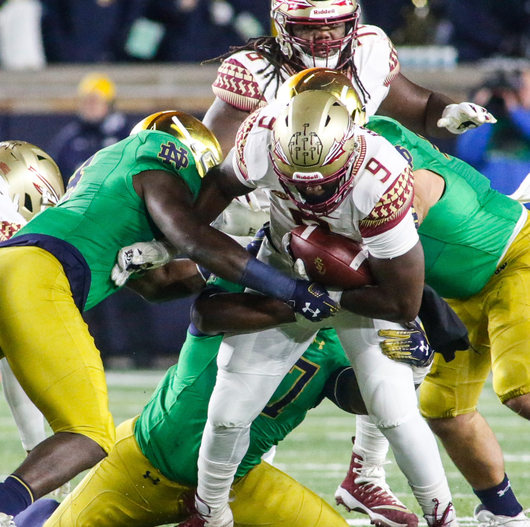 Florida State senior running back Jaques Patrick, 9, struggles to break through the Notre Dame defensive line during the second quarter in South Bend on Saturday.