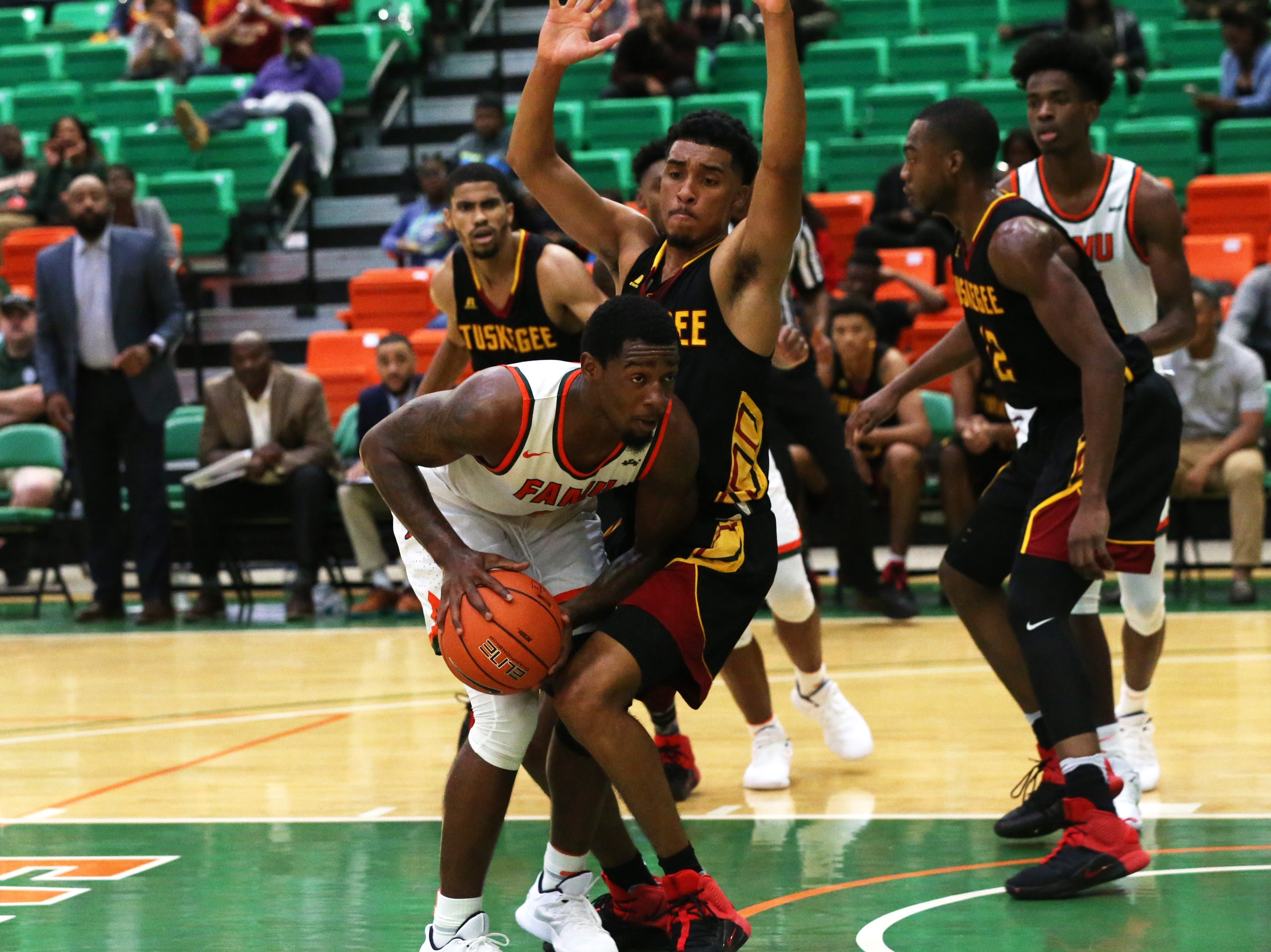 Florida A&M Rattlers forward Tracy Hector Jr. (0) looks for an open teammate as the FAMU Rattlers take on the Tuskegee Golden Tigers in their first home game of the season in the Lawson Center, Saturday, Nov. 10, 2018.