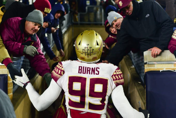 Florida State junior defensive end Brian Burns greets Seminole fans as he walks off the field at Notre Dame on Saturday.