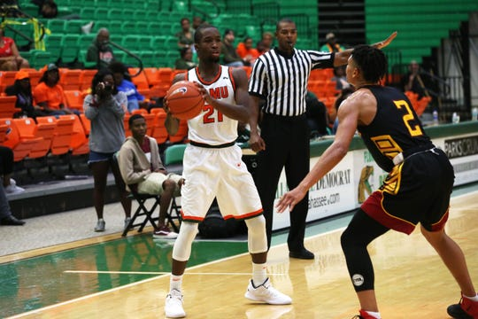 FAMU guard Justin Ravenel (21) looks to pass from the wing against Tuskegee.