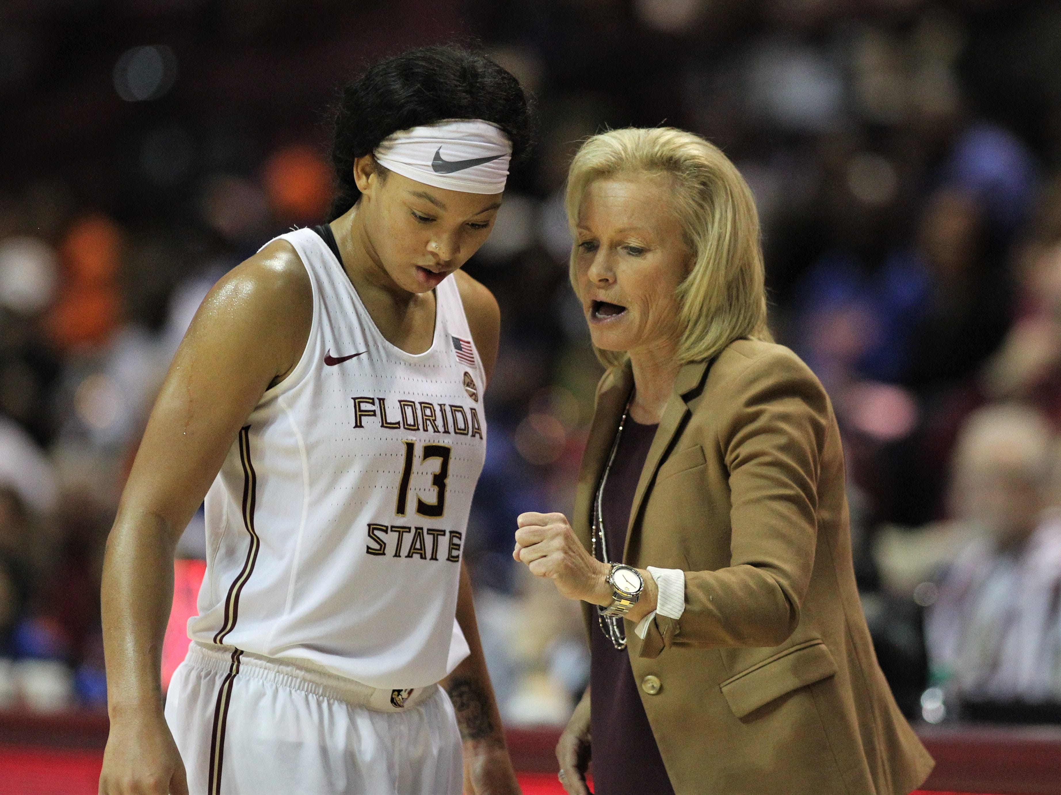 Florida State women's basketball coach Sue Semrau talks to Nausia Woolfolk during a game at the Tucker Civic Center.