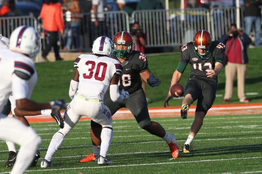 FAMU's Chris Faddoul punts the ball against South Carolina State. Three of the the first-team AP All-American's four punts against the Bulldogs landed inside the 20-yard line.