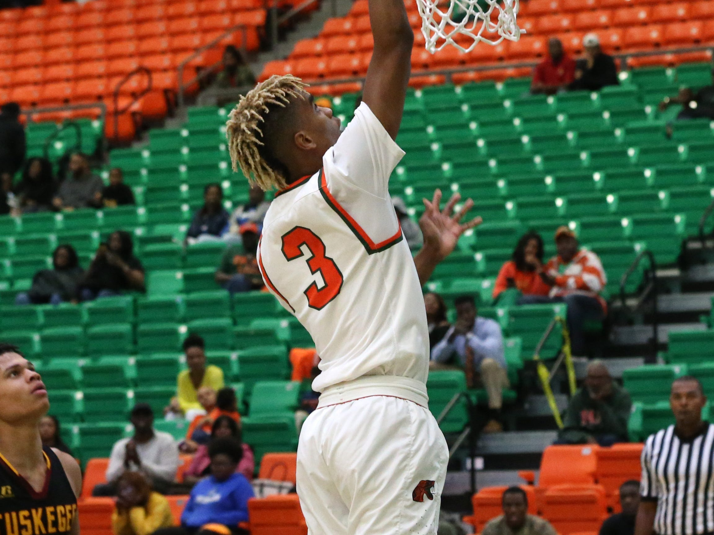 Florida A&M Rattlers guard MJ Randolph (3) makes a layup as the FAMU Rattlers take on the Tuskegee Golden Tigers in their first home game of the season in the Lawson Center, Saturday, Nov. 10, 2018.