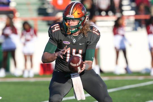 FAMU quarterback Ryan Stanley prepares for the handoff versus South Carolina State at Bragg Memorial stadium, Saturday, Nov. 10, 2018.