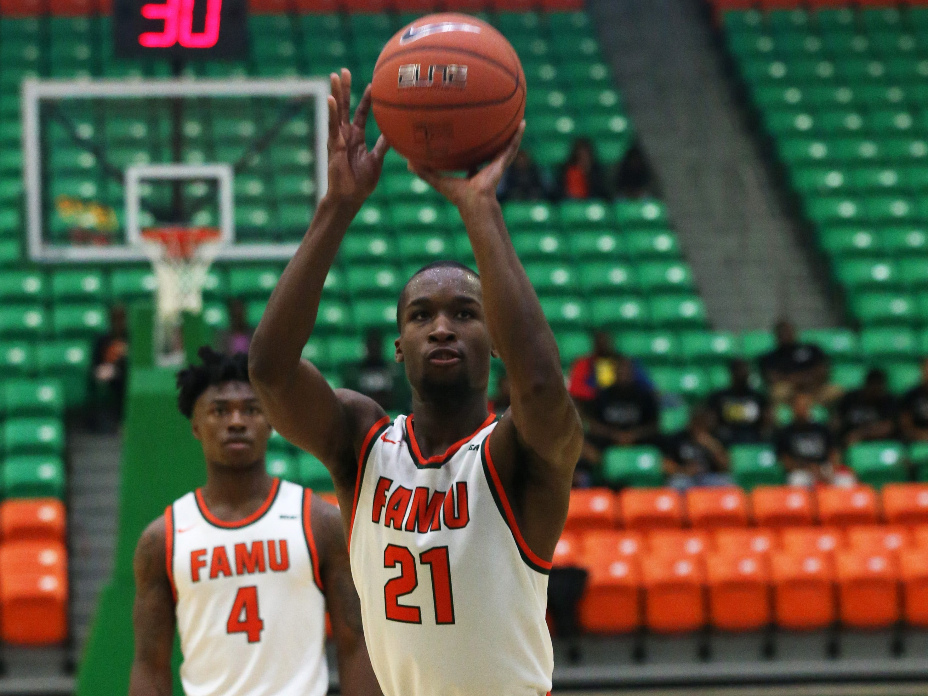 Florida A&M Rattlers guard Justin Ravenel (21) shoots a free throw as the FAMU Rattlers take on the Tuskegee Golden Tigers in their first home game of the season in the Lawson Center, Saturday, Nov. 10, 2018.
