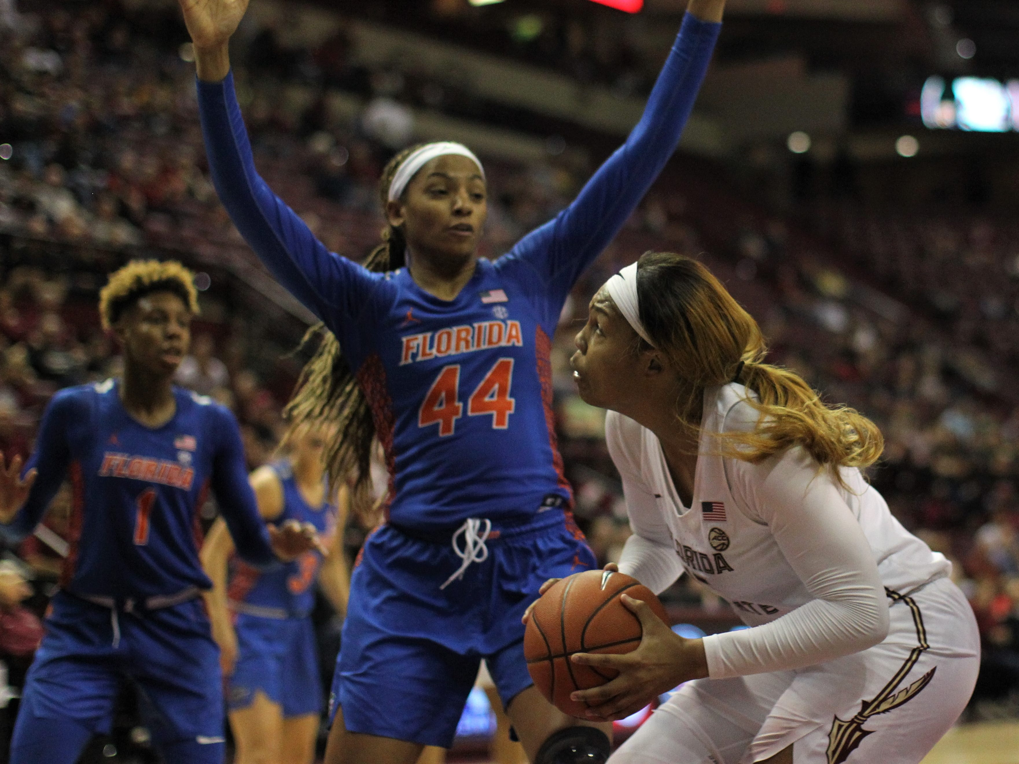 Florida State's Kiah Gillespie pump fakes a UF's Paige Robinson during the second half of the Seminoles' game against Florida at the Tucker Civic Center on Nov. 11, 2018.