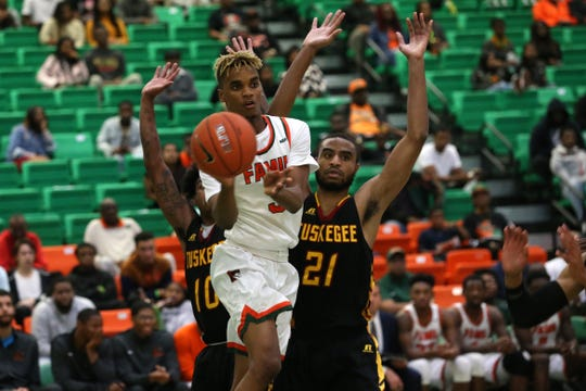 FAMU guard M.J. Randolph (3) passes to a teammate. The Rattlers defeated Tuskegee 62-55 in their home opener.