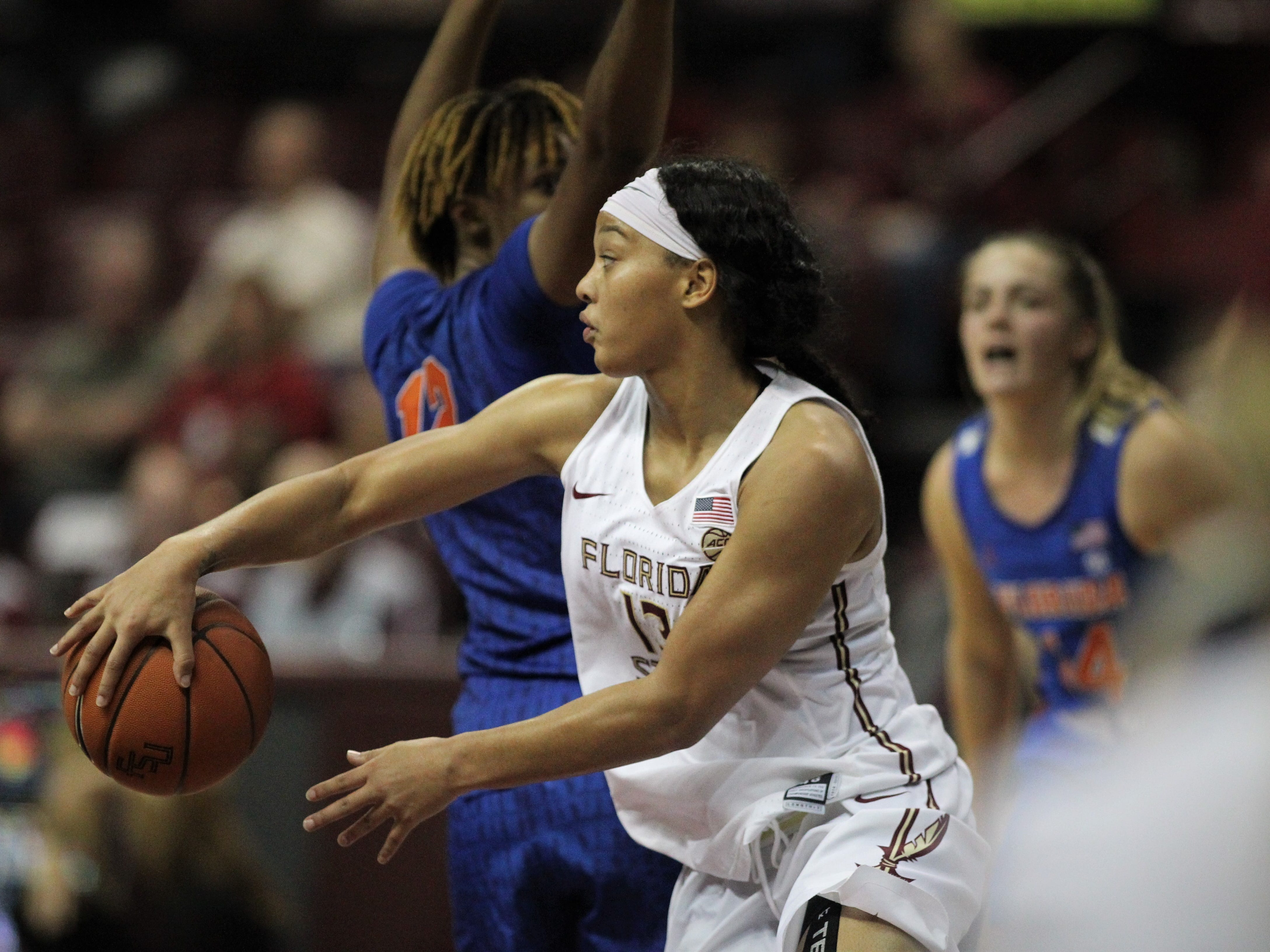 Florida State's Nausia Woolfolk throws a wrap-around pass during the second half of the Seminoles' game against Florida at the Tucker Civic Center on Nov. 11, 2018.