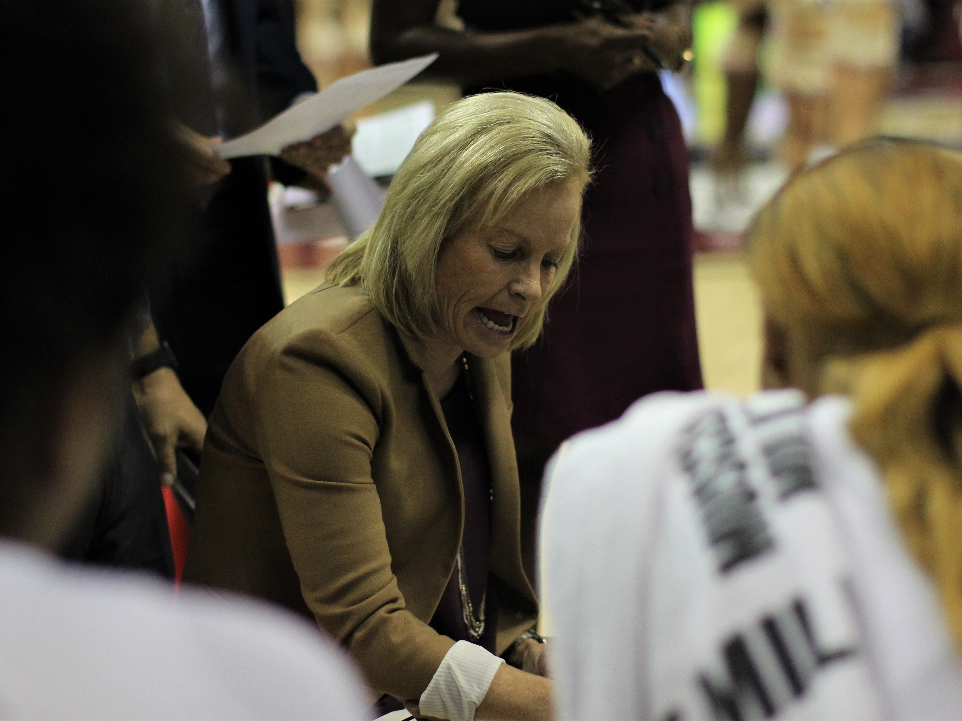 Florida State women's basketball head coach Sue Semrau draws up a play during the second half of the Seminoles' game against Florida at the Tucker Civic Center on Nov. 11, 2018.