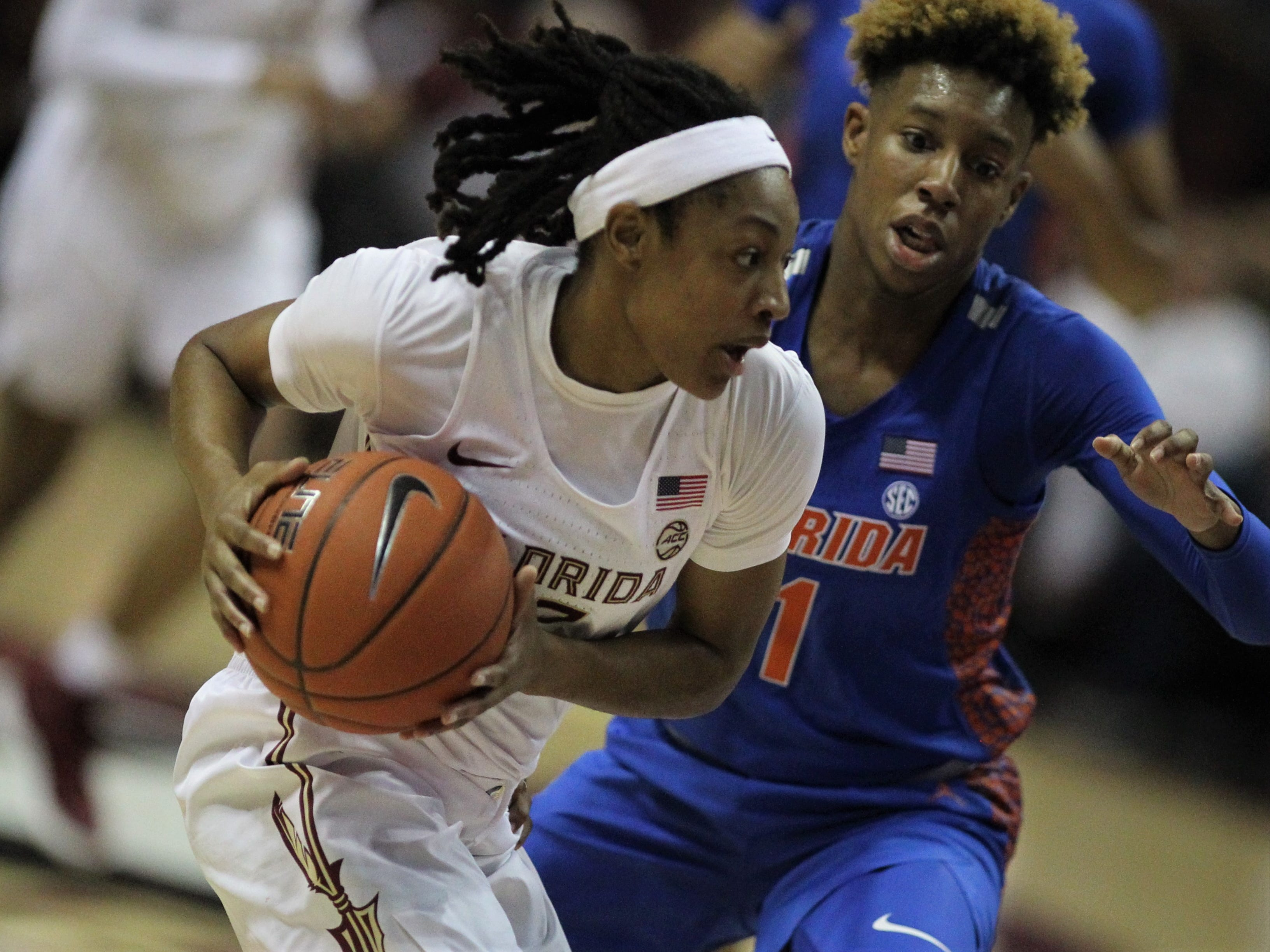 Florida State's Nicki Ekhomu drives past Florida's Kiara Smith during the first half of the Seminoles' game against the Gators at the Tucker Civic Center on Nov. 11, 2018.