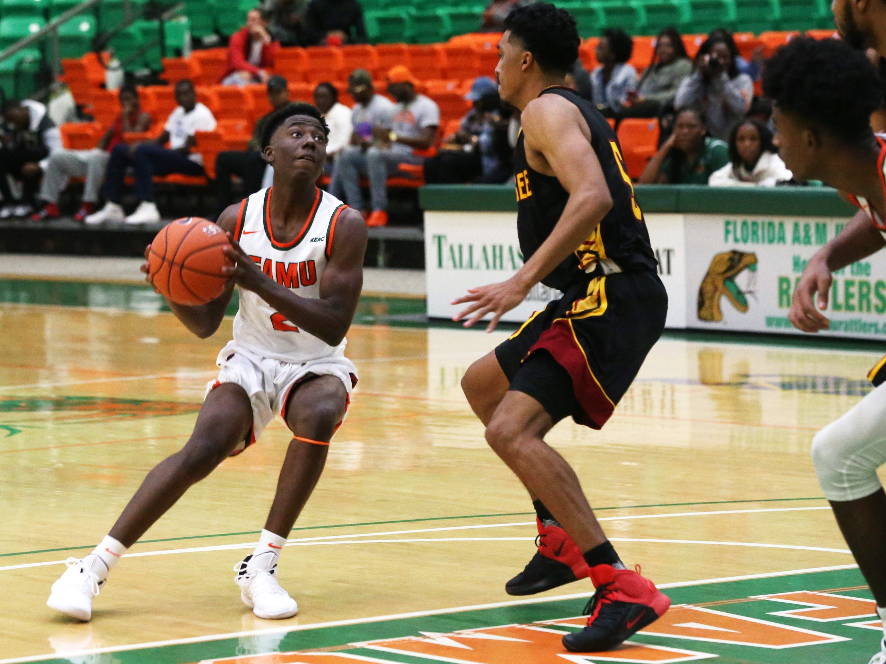 Florida A&M guard Kamron Reaves (2) looks to shoot over Tuskegee's defense. The Rattlers won their first home game of the season on Saturday, Nov. 10.