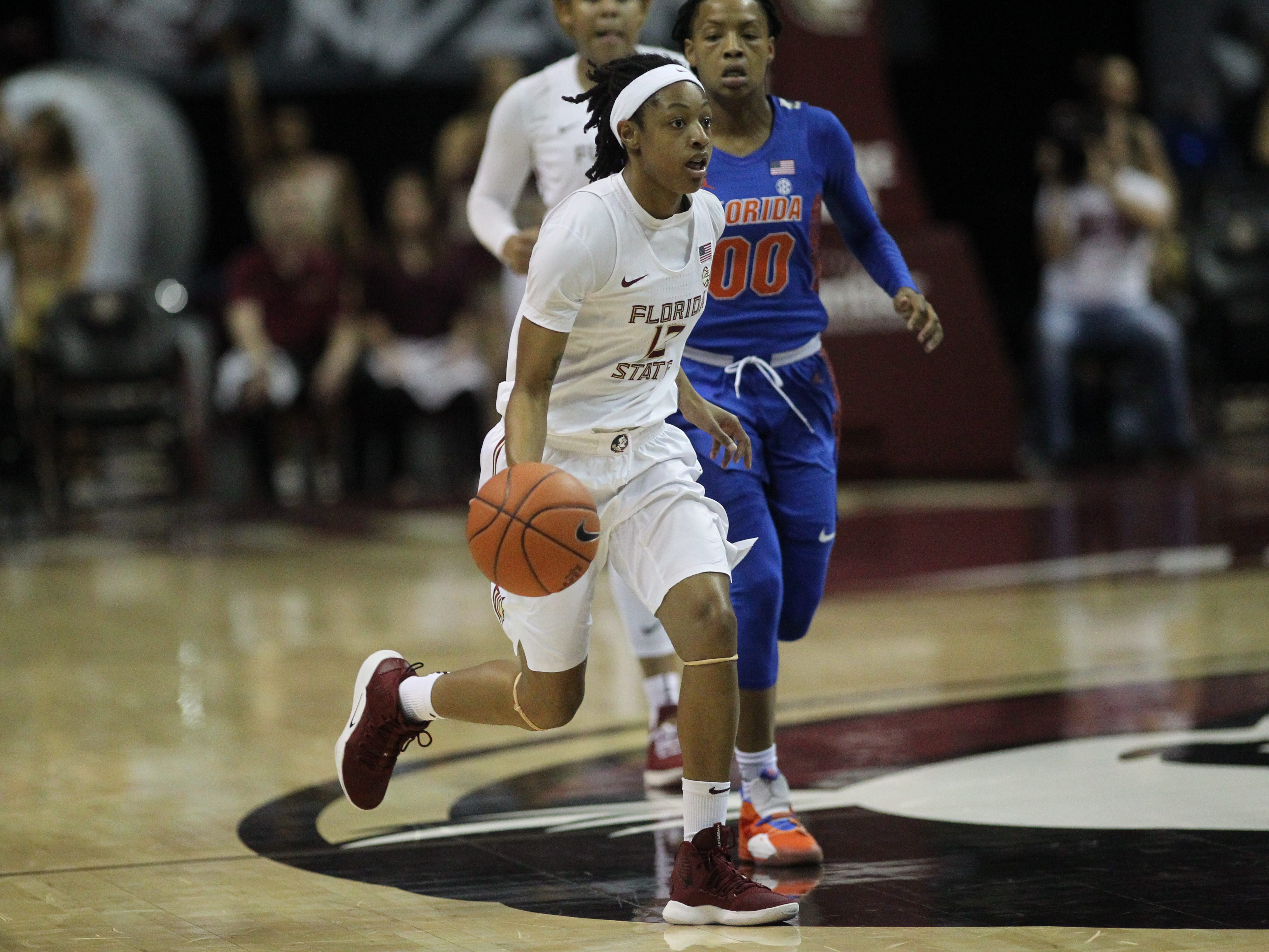 Florida State's Nicki Ekhomu dribbles on a fastbreak during the first half of the Seminoles' game against Florida at the Tucker Civic Center on Nov. 11, 2018.