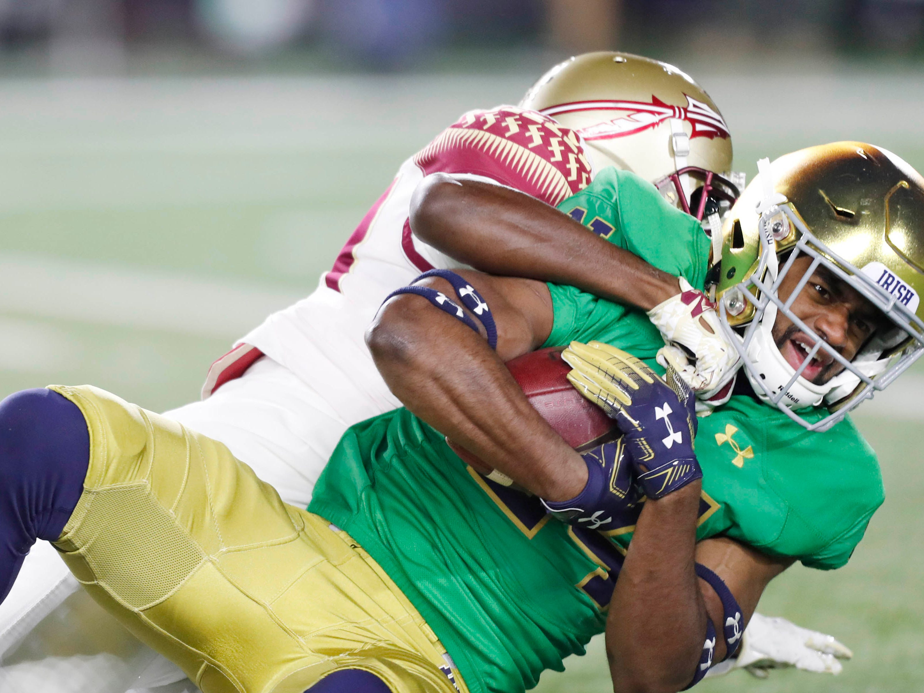 Nov 10, 2018; South Bend, IN, USA; Notre Dame Fighting Irish safety Nick Coleman (24) after making an interception is tackled by the Florida State Seminoles during the first quarter at Notre Dame Stadium. Mandatory Credit: Brian Spurlock-USA TODAY Sports