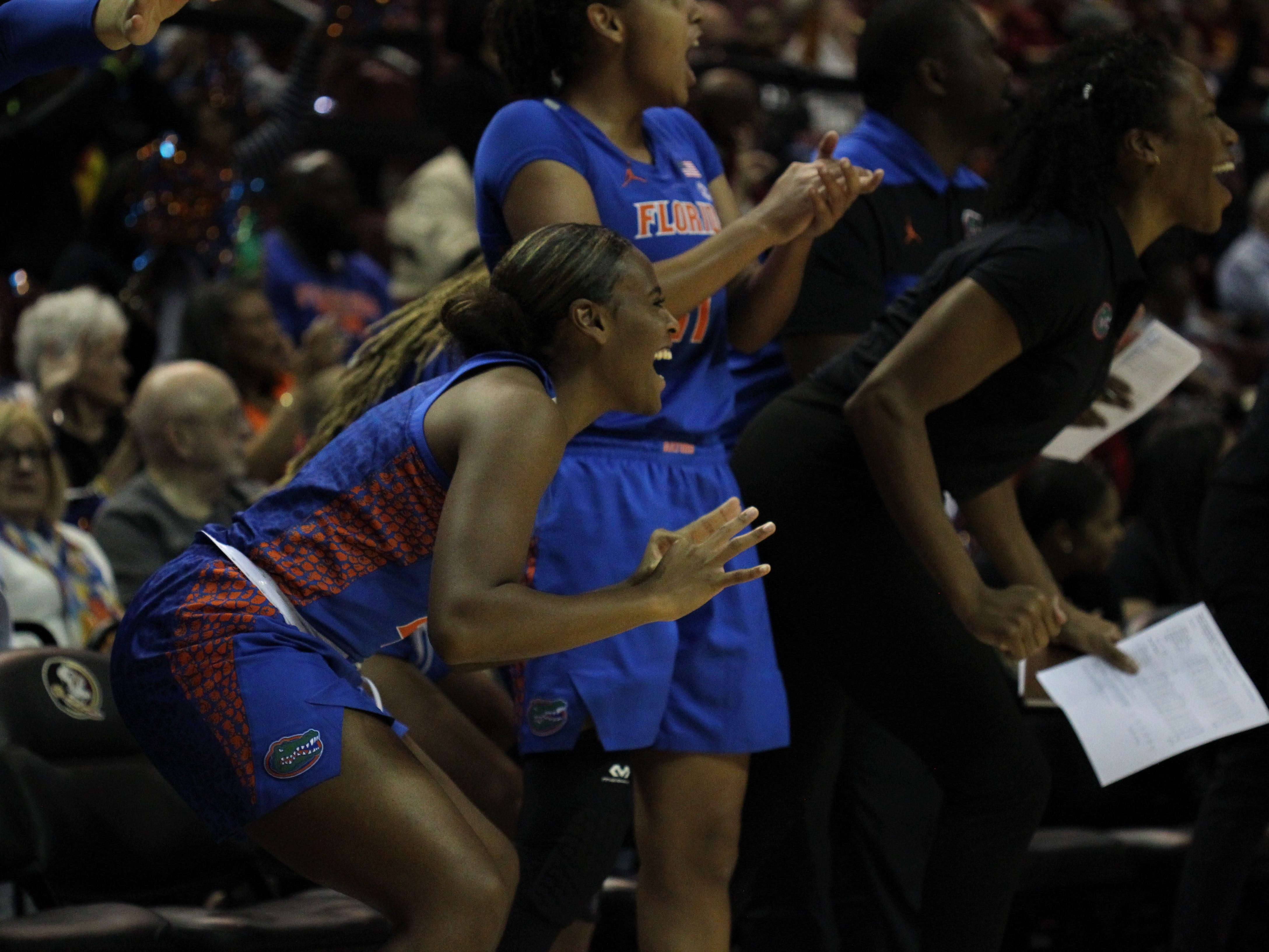 Florida players cheer a basket during the first half of a game against Florida State the Tucker Civic Center on Nov. 11, 2018.