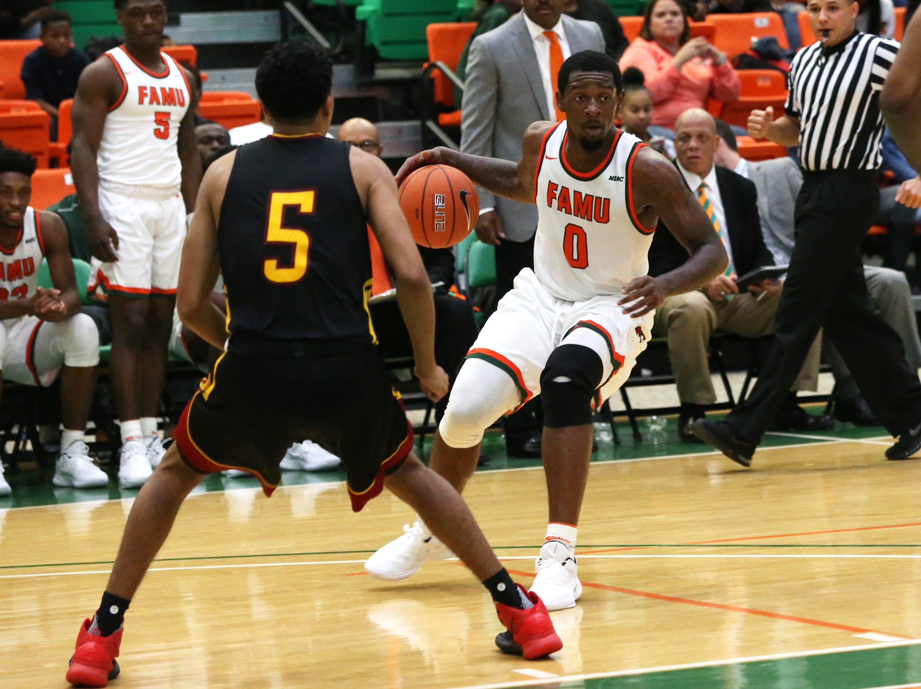 Florida A&M Rattlers forward Tracy Hector Jr. (0) looks to figure out his next move as the FAMU Rattlers take on the Tuskegee Golden Tigers in their first home game of the season in the Lawson Center, Saturday, Nov. 10, 2018.
