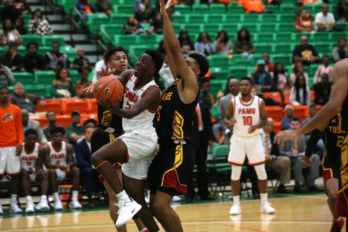 FAMU guard Kamron Reaves (2) drives to the hoop against Tuskegee. He scored 11 points in the team's 62-55 victory.