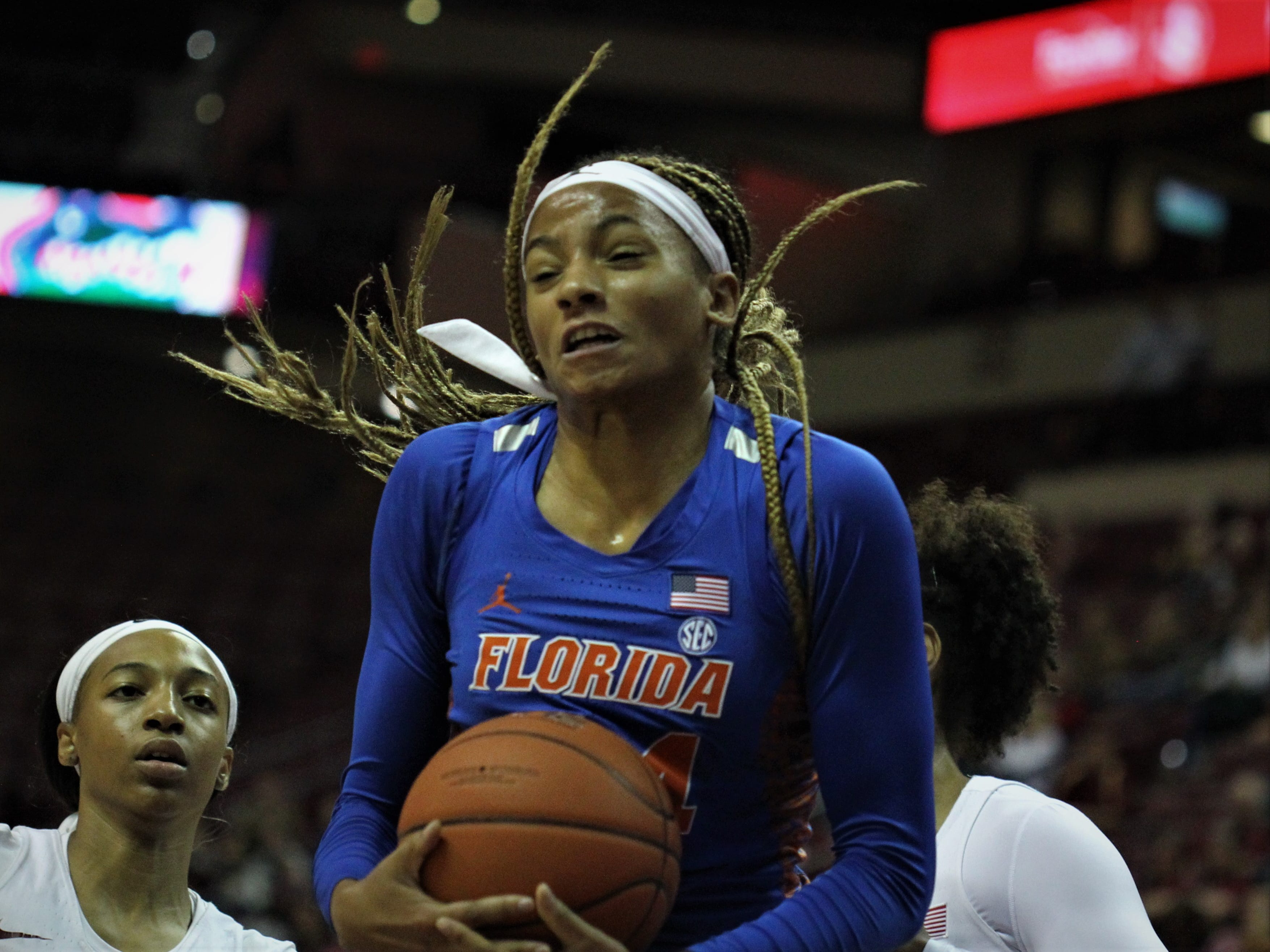 Florida's Paige Robinson grabs a rebound during the first half of a game against Florida State at the Tucker Civic Center on Nov. 11, 2018.
