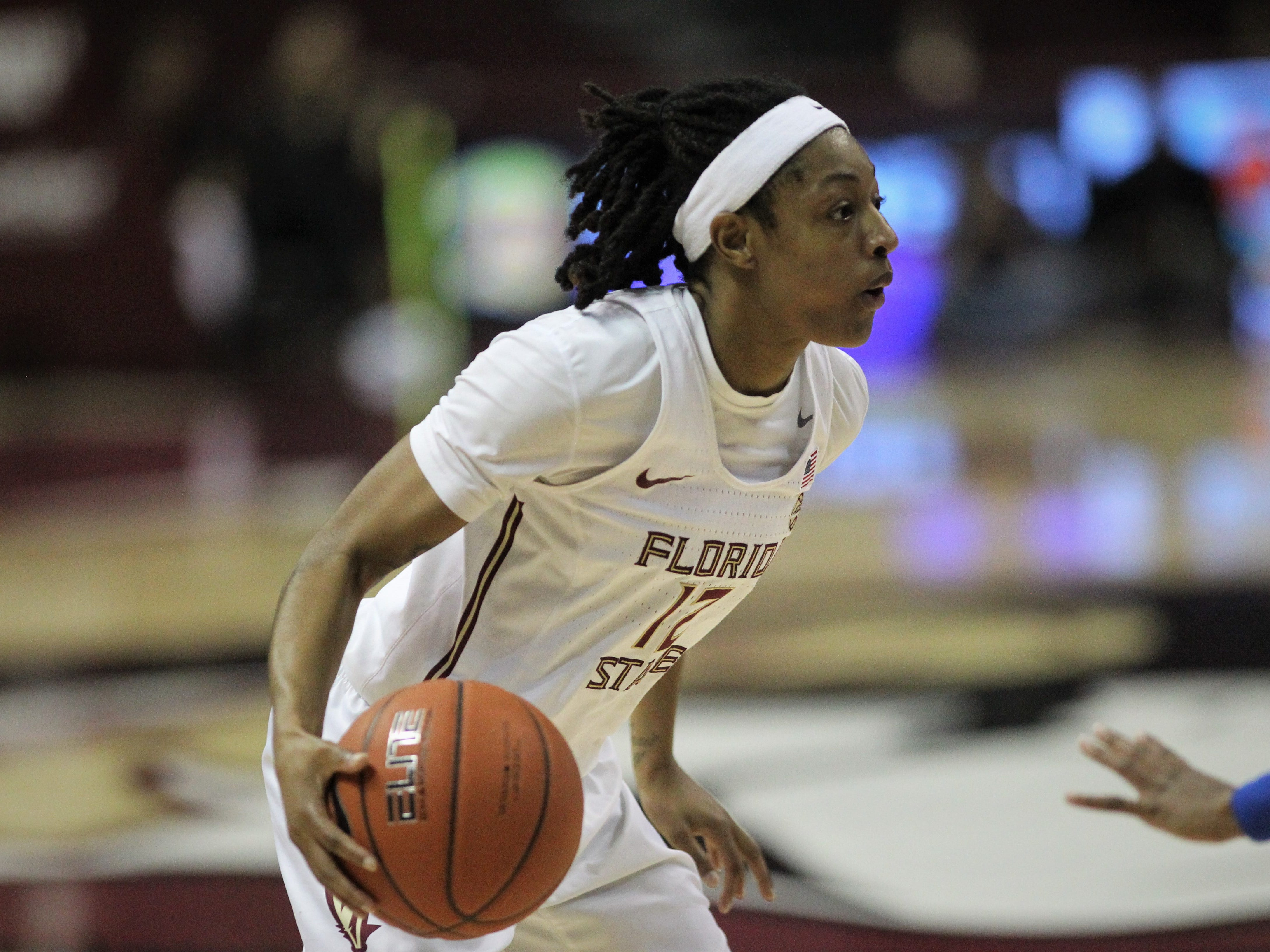 Florida State's Nicki Ekhomu brings the ball up the court during the second half of the Seminoles' game against Florida at the Tucker Civic Center on Nov. 11, 2018.