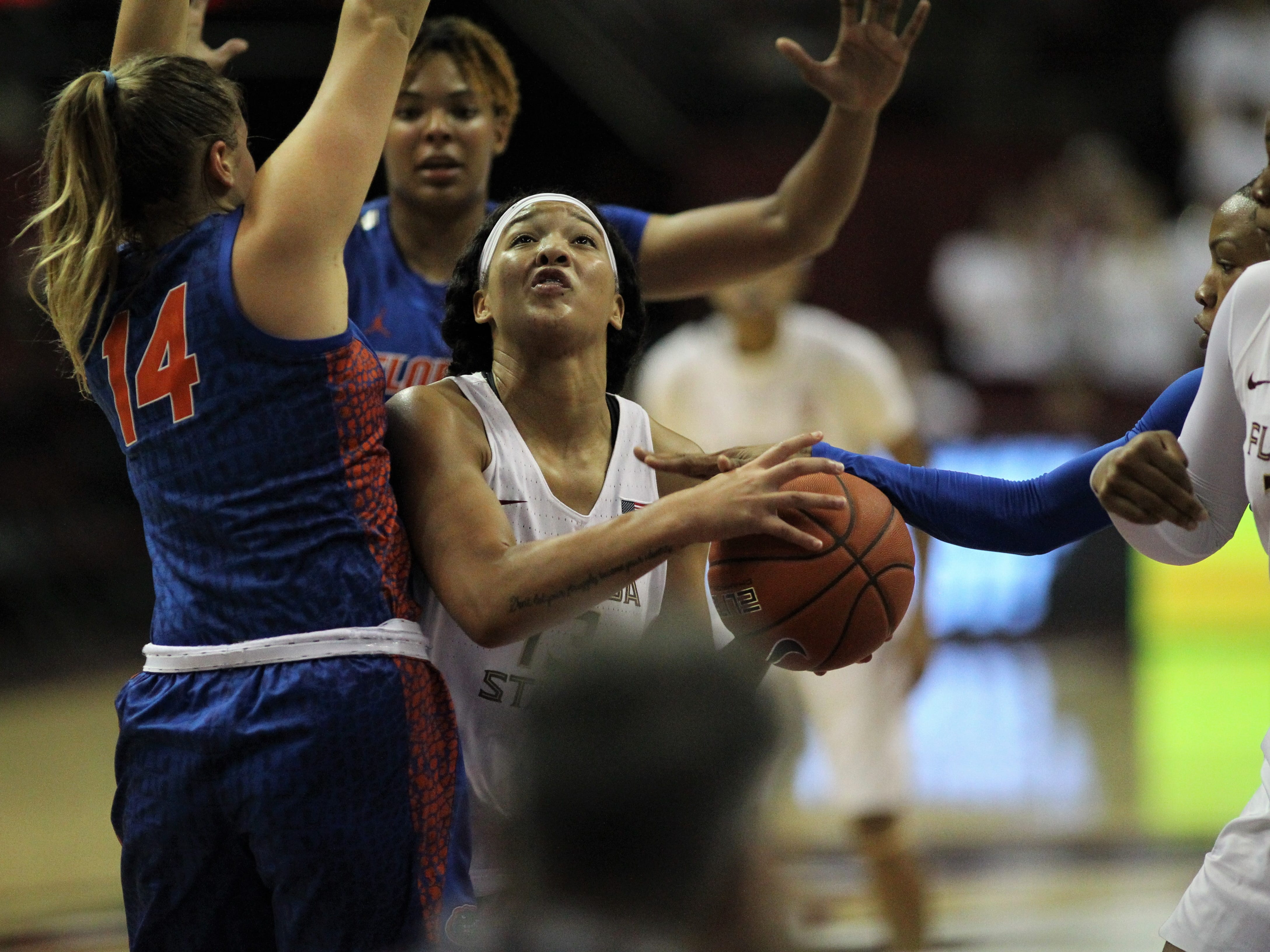 Florida State's Nausia Woolfolk tries to go up for a layup but is fouled during the second half of the Seminoles' game against Florida at the Tucker Civic Center on Nov. 11, 2018.