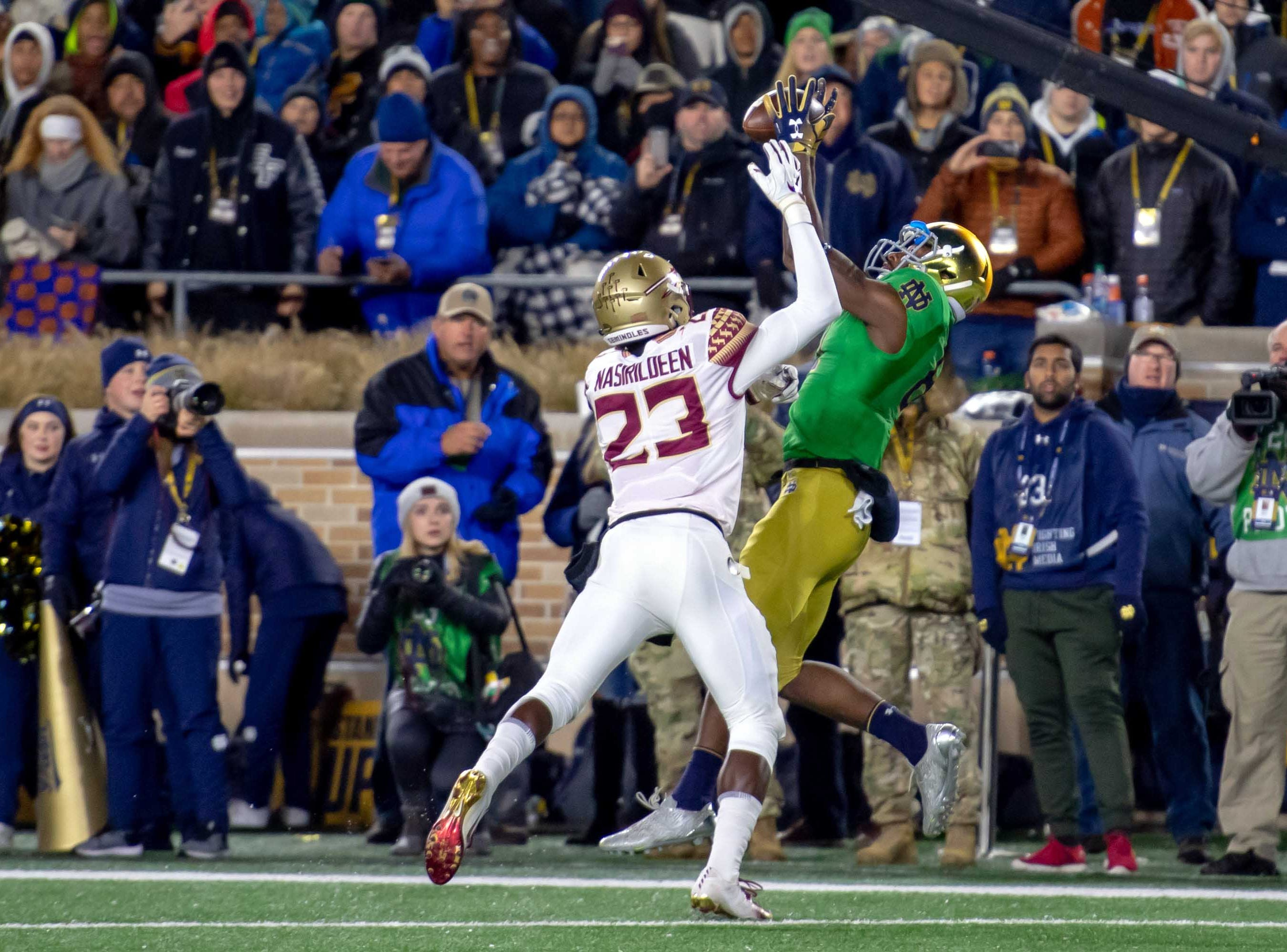 Nov 10, 2018; South Bend, IN, USA; Notre Dame Fighting Irish wide receiver Miles Boykin (81) catches a pass for a touchdown as Florida State Seminoles safety Hamsah Nasirildeen (23) defends in the first quarter at Notre Dame Stadium. Mandatory Credit: Matt Cashore-USA TODAY Sports