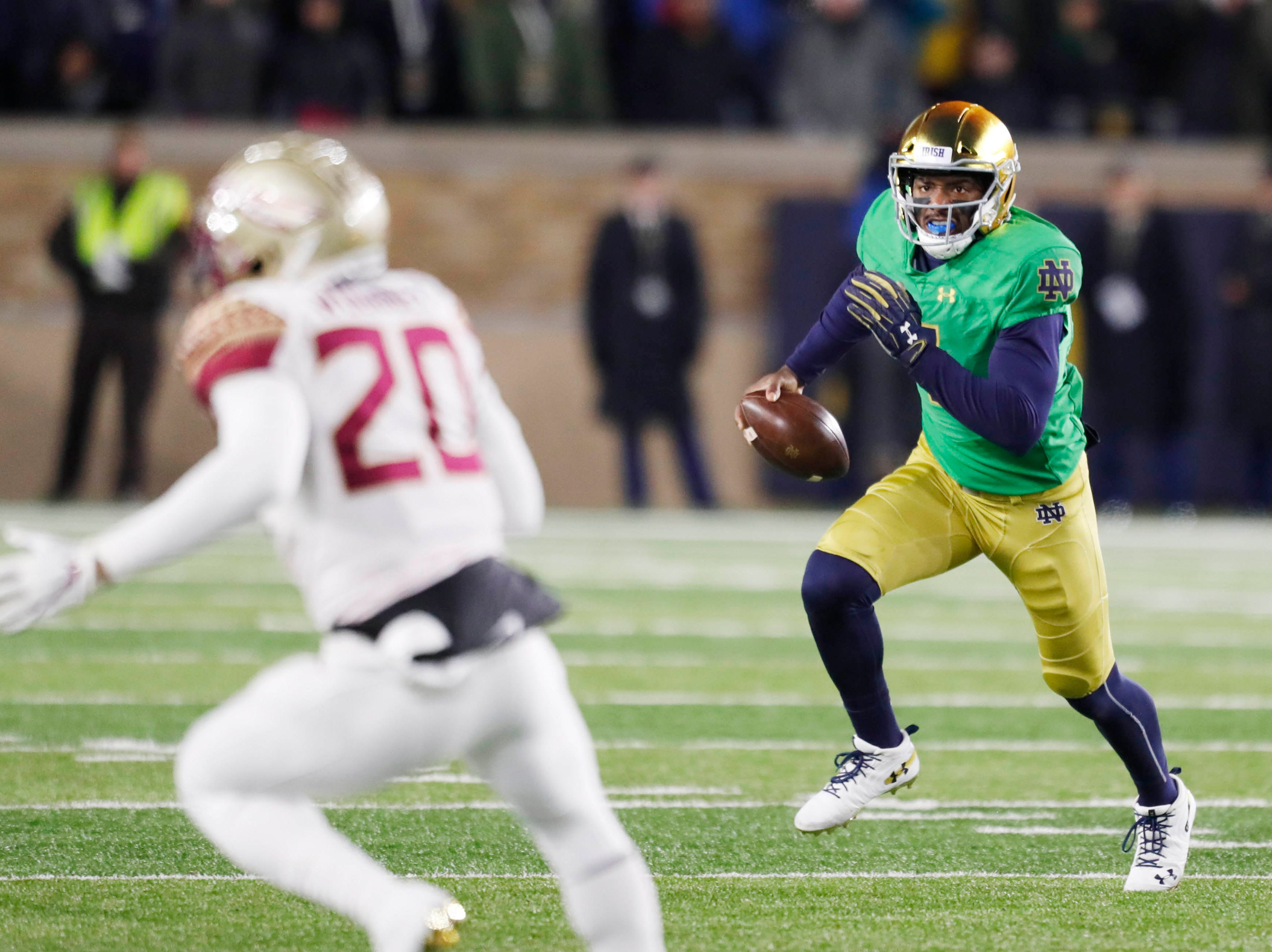 Nov 10, 2018; South Bend, IN, USA; Notre Dame Fighting Irish quarterback Brandon Wimbush (7) scrambles out of the pocket against the Florida State Seminoles during the first quarter at Notre Dame Stadium. Mandatory Credit: Brian Spurlock-USA TODAY Sports