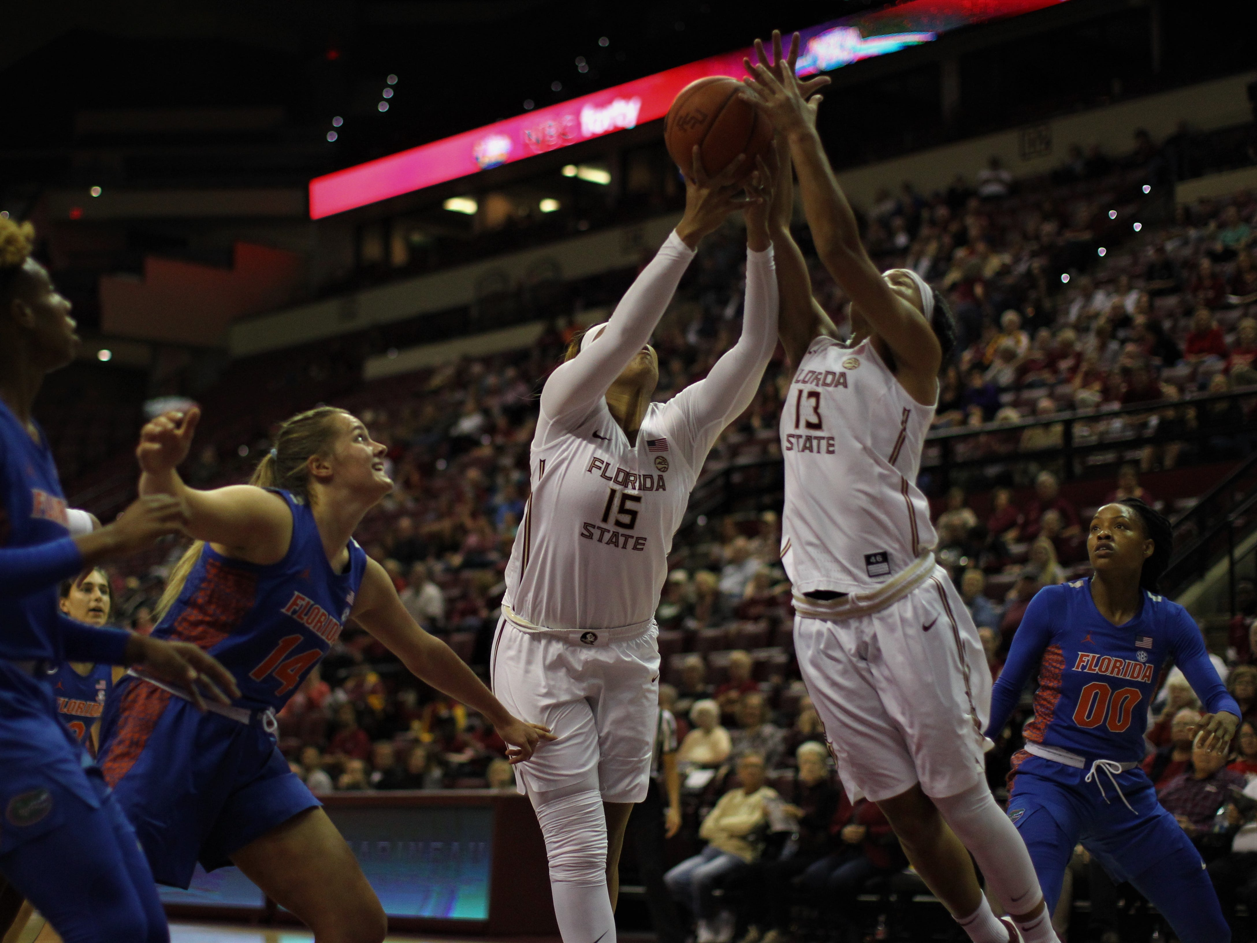 Florida State's Kiah Gillespie (15) and Nausia Woolfolk (13) try to grab a rebound during the first half of the Seminoles' game against Florida at the Tucker Civic Center on Nov. 11, 2018.