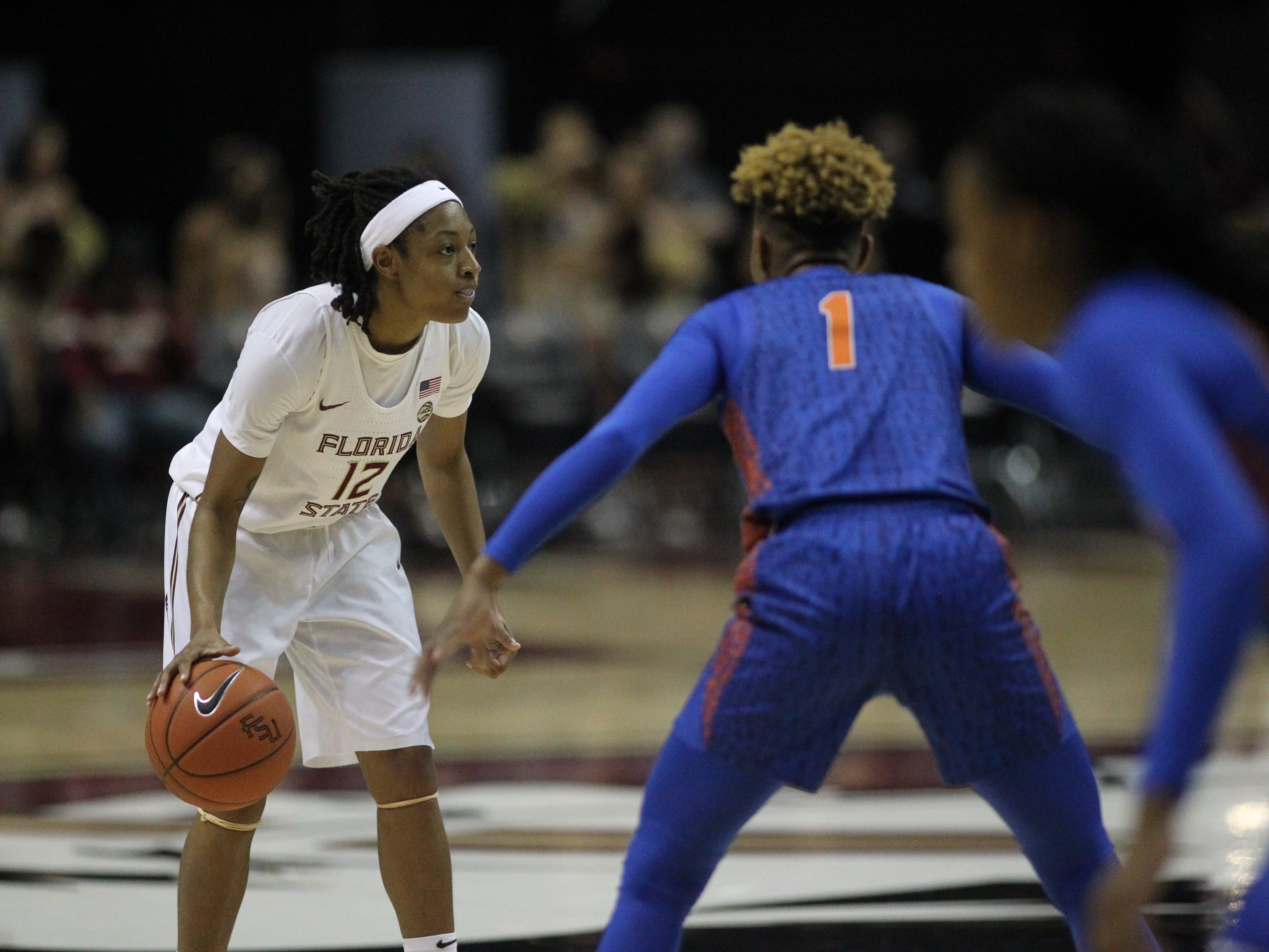 Florida State's Nicki Ekhomu looks for a pass during the first half of the Seminoles' game against Florida at the Tucker Civic Center on Nov. 11, 2018.