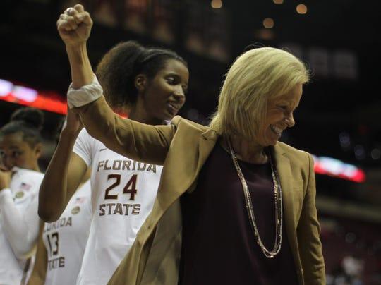 Florida State women's basketball coach Sue Semrau celebrates a win over Florida at the Tucker Civic Center on Nov. 11, 2018.