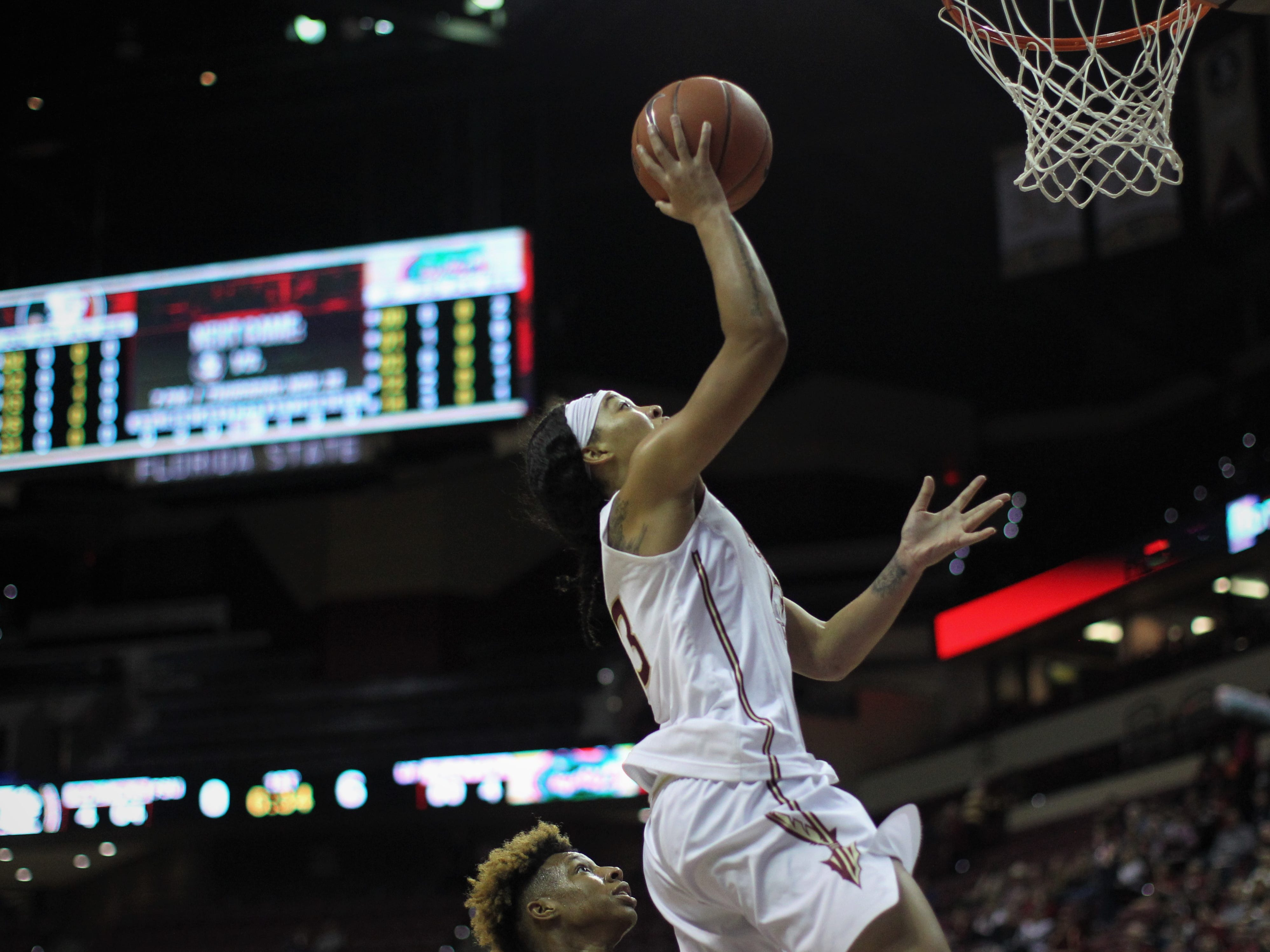 Florida State junior guard Nausia Woolfolk goes in for a layup during the first half of the Seminoles' game against Florida at the Tucker Civic Center on Nov. 11, 2018.