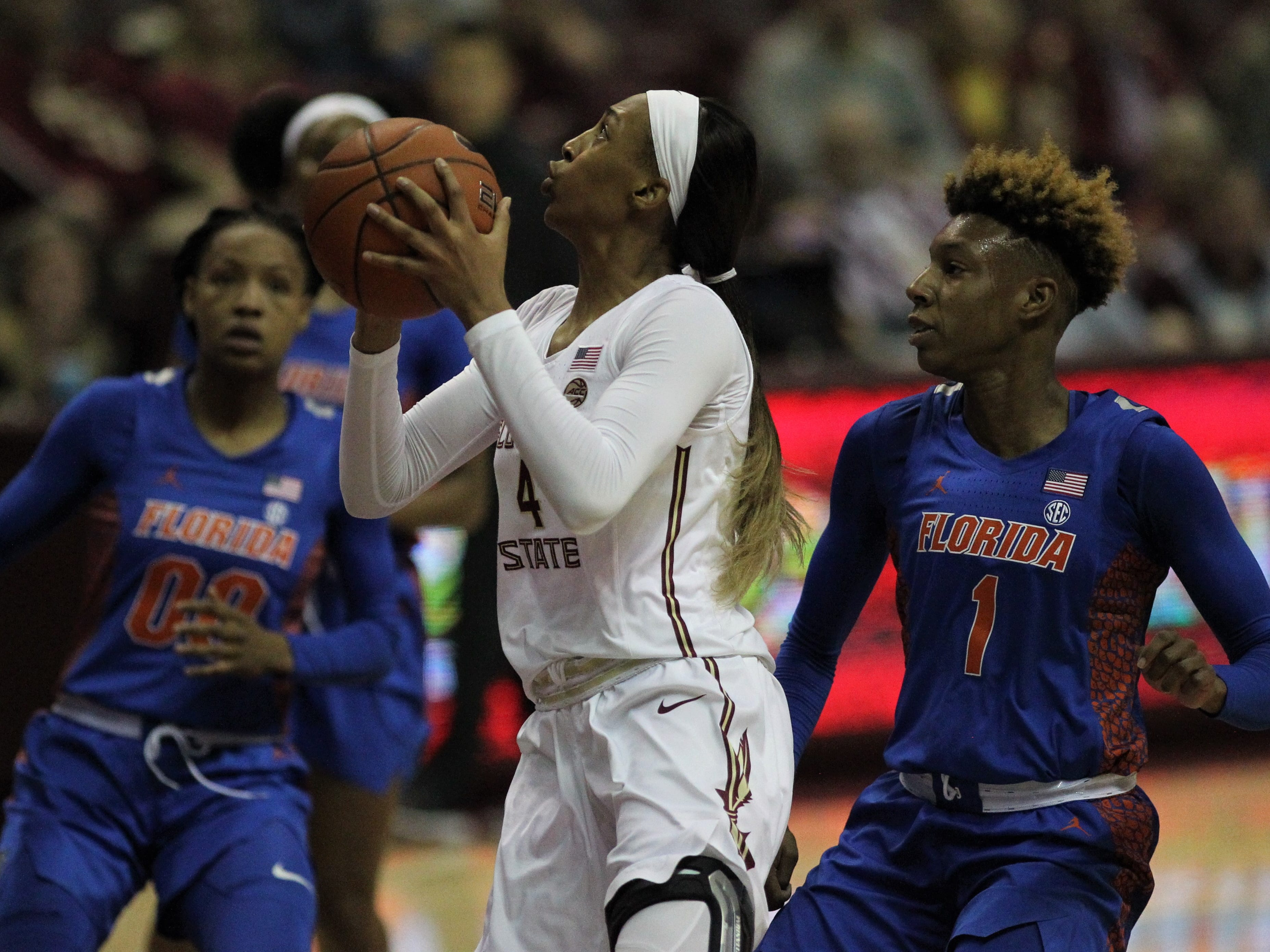 Florida State freshman Amaya Brown gues up for a layup during the first half of the Seminoles' game against Florida at the Tucker Civic Center on Nov. 11, 2018.