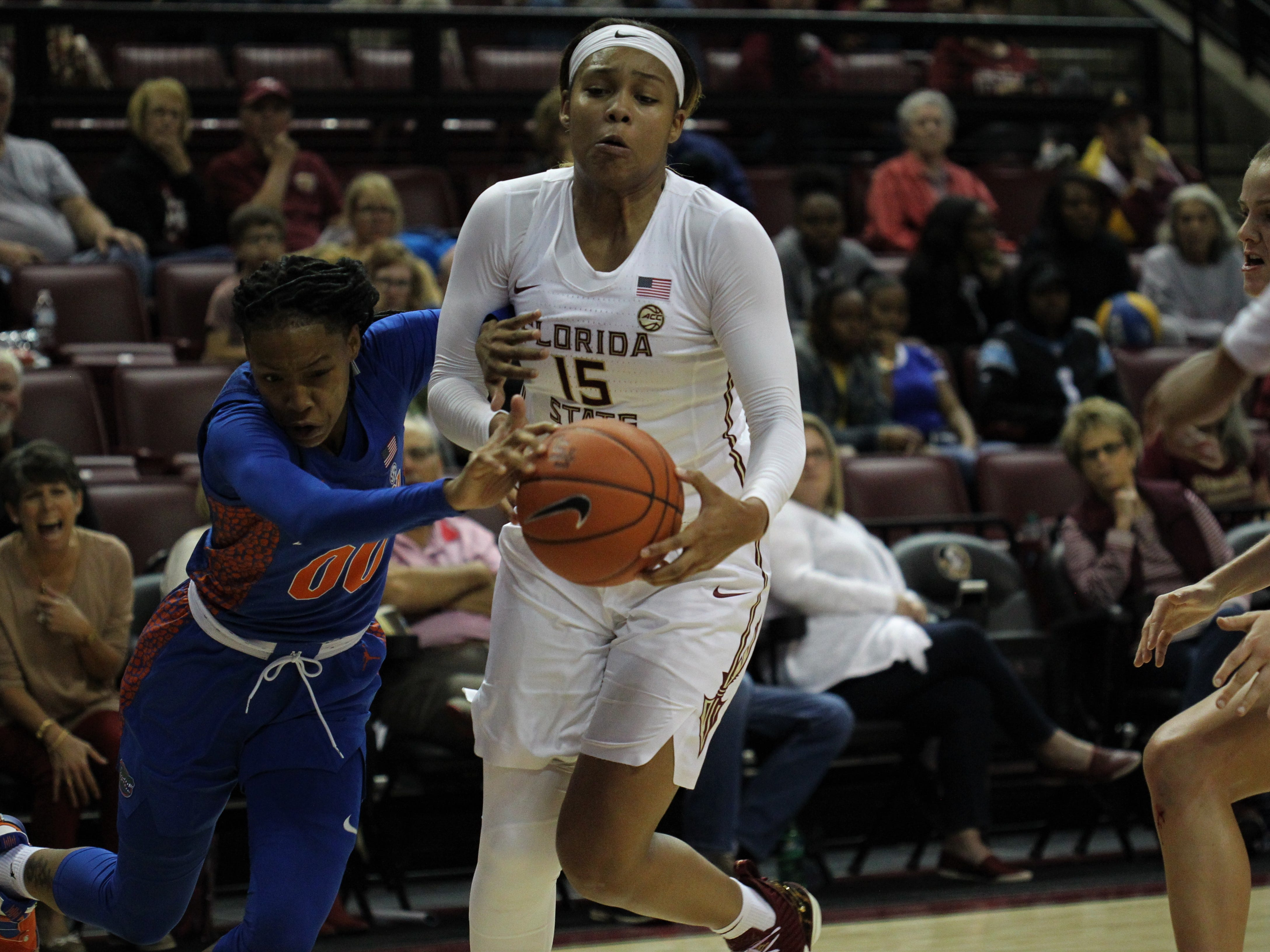 Florida State's Kiah Gillespie and UF's Delicia Washington fight for a loose ball during the second half of the Seminoles' game against Florida at the Tucker Civic Center on Nov. 11, 2018.