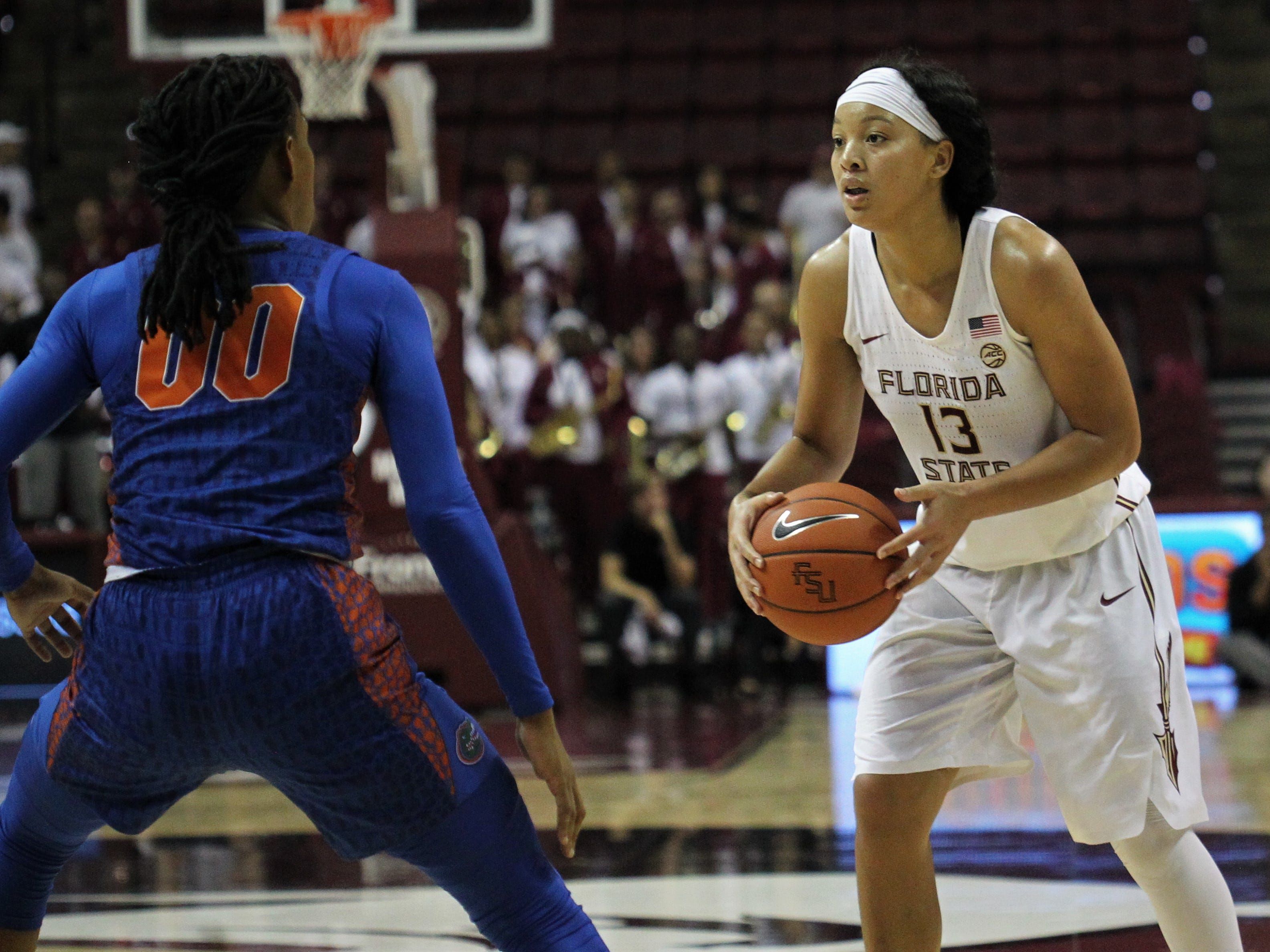 Florida State's Nausia Woolfolk sizes up UF's defense during the second half of the Seminoles' game against Florida at the Tucker Civic Center on Nov. 11, 2018.
