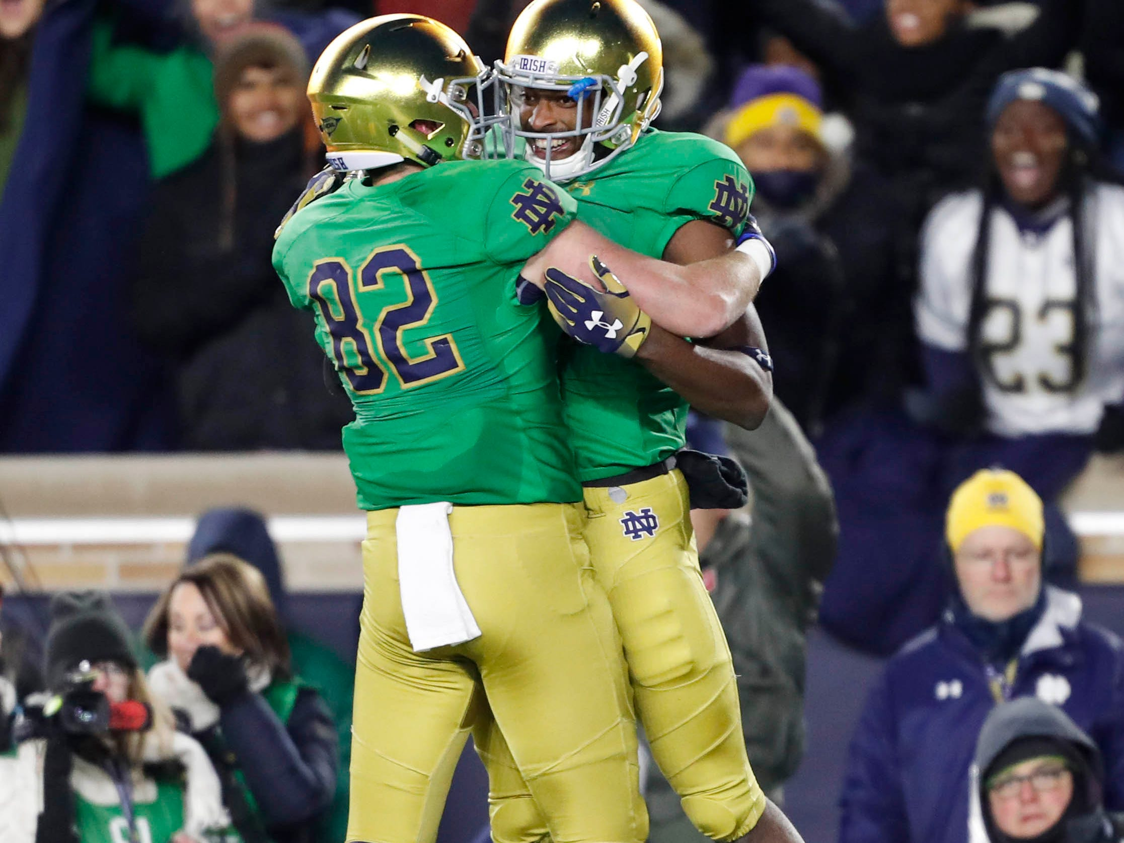 Nov 10, 2018; South Bend, IN, USA; Notre Dame Fighting Irish wide receiver Miles Boykin (81) is congratulated by tight end Nic Weishar (82) after catching a touchdown pass in the end zone against the Florida State Seminoles during the first quarter at Notre Dame Stadium. Mandatory Credit: Brian Spurlock-USA TODAY Sports
