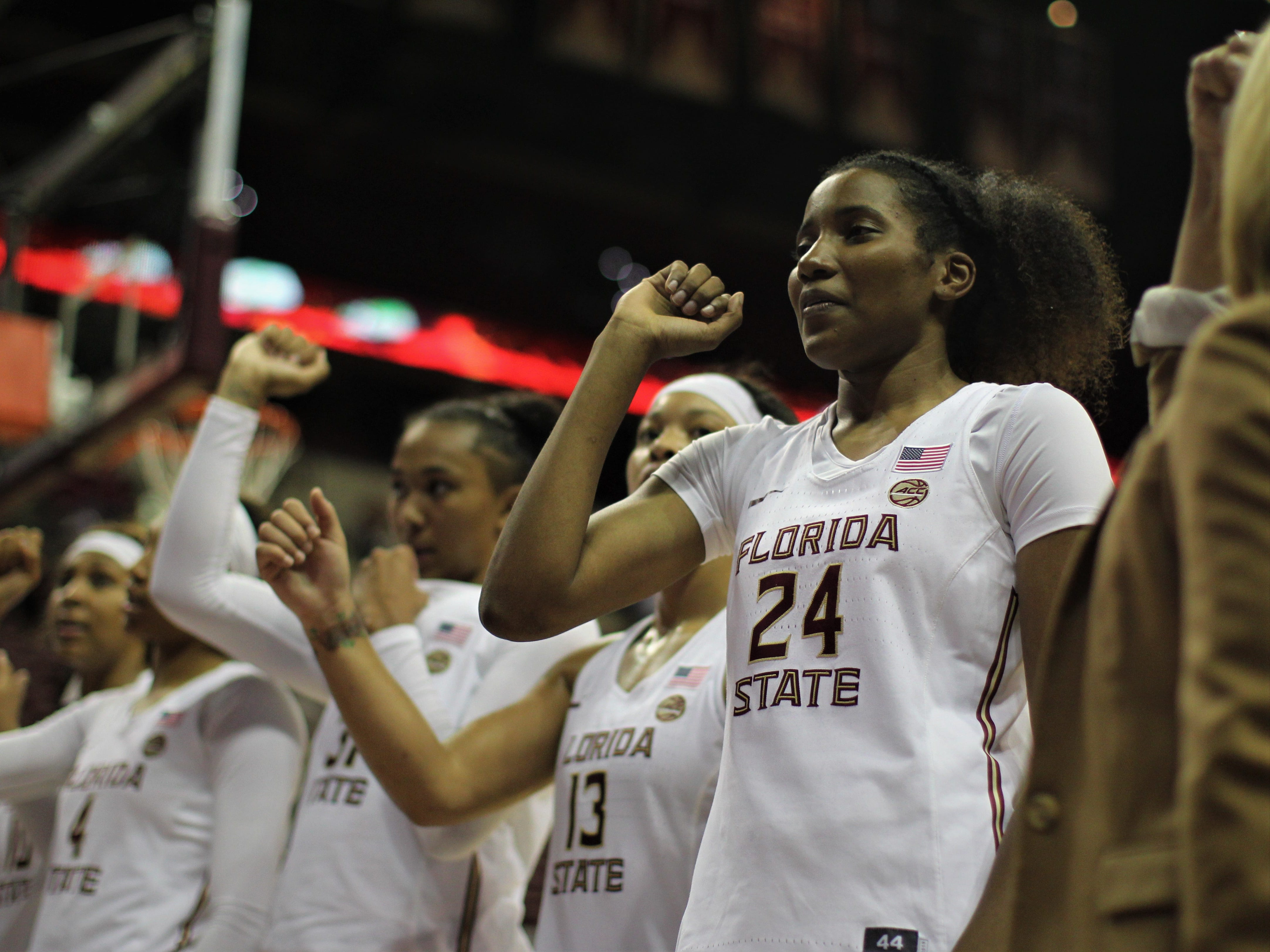 Florida State's Morgan Jones (24) does the FSU fight song with her teammates to celebrate a win over Florida at the Tucker Civic Center on Nov. 11, 2018.