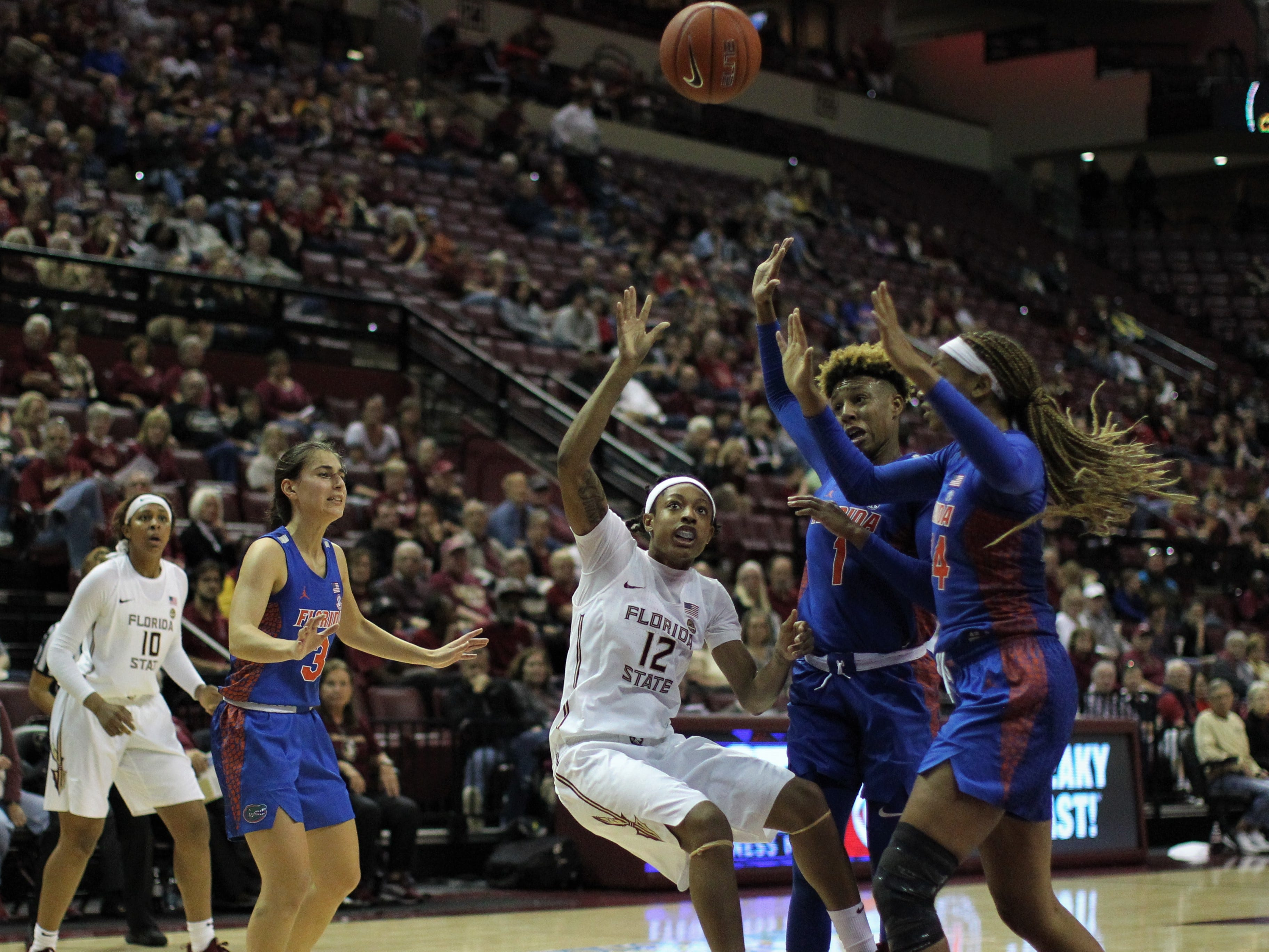 Florida State's Nicki Ekhomu throws up an off-balance shot because of contact during the second half of the Seminoles' game against Florida at the Tucker Civic Center on Nov. 11, 2018.