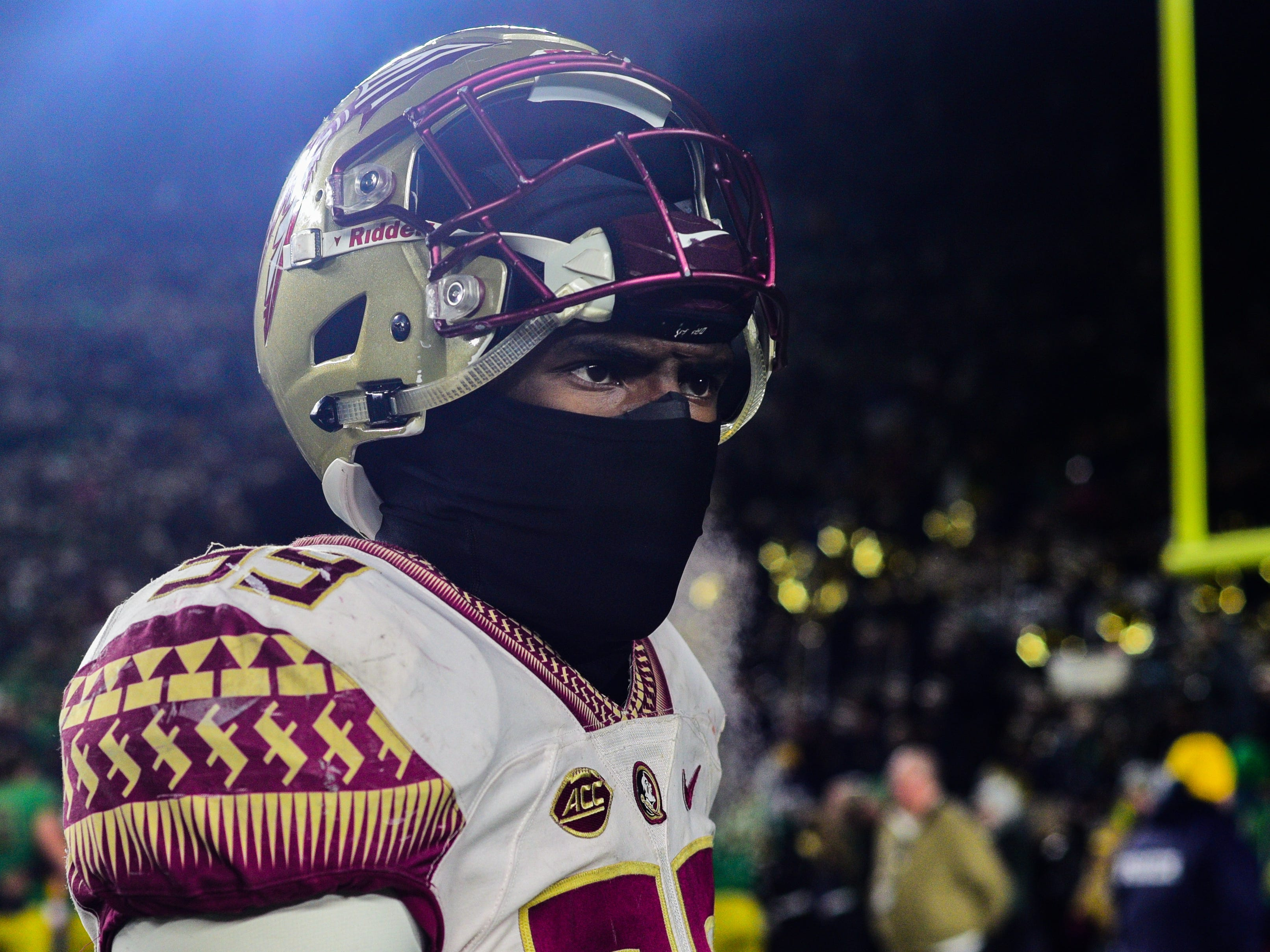 Florida State junior defensive end Brian Burns walks off the field in anger after the Seminoles were blown out 42-13 by Notre Dame in South Bend on Saturday.