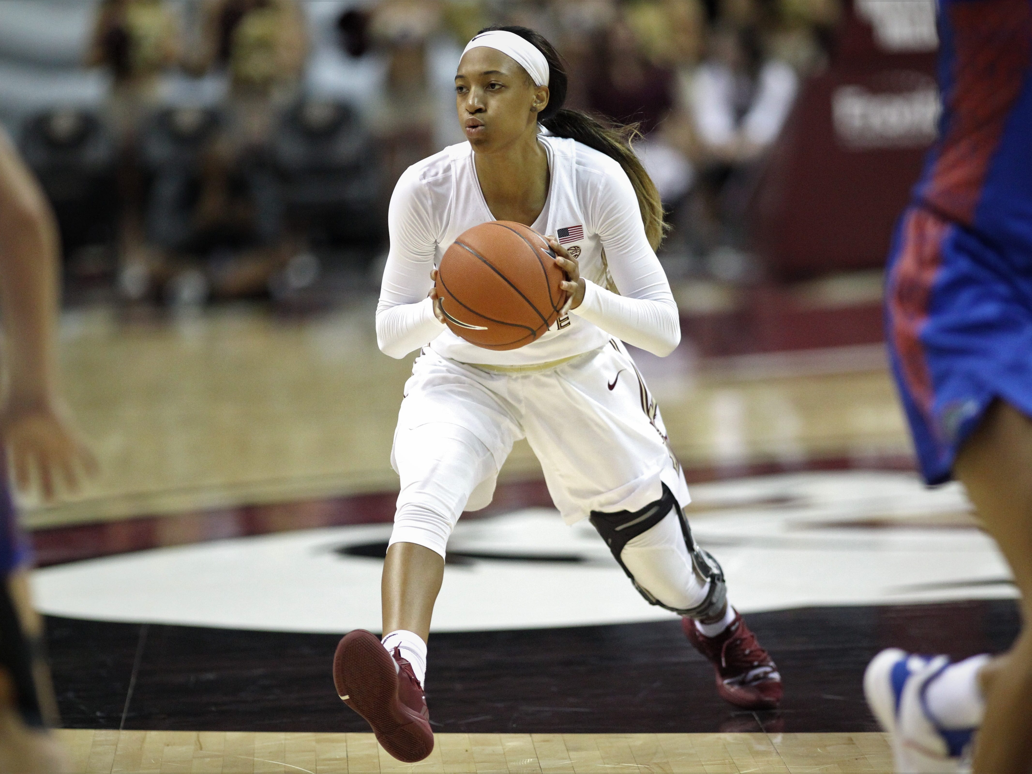 Florida State freshman guard Amaya Brown makes a pass during the first half of the Seminoles' game against Florida at the Tucker Civic Center on Nov. 11, 2018.