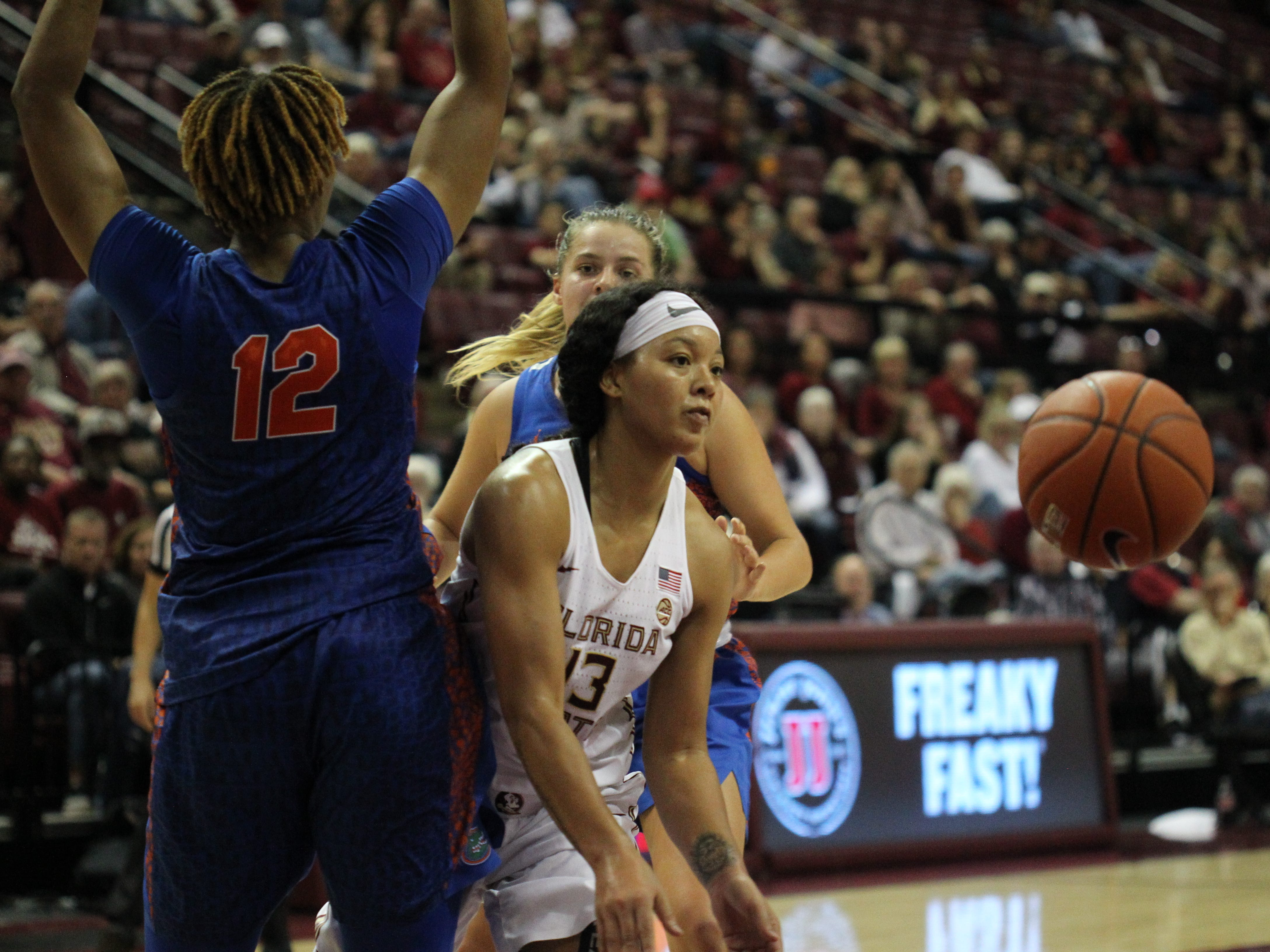 Florida State's Nausia Woolfolk flips an underhanded pass during the second half of the Seminoles' game against Florida at the Tucker Civic Center on Nov. 11, 2018.
