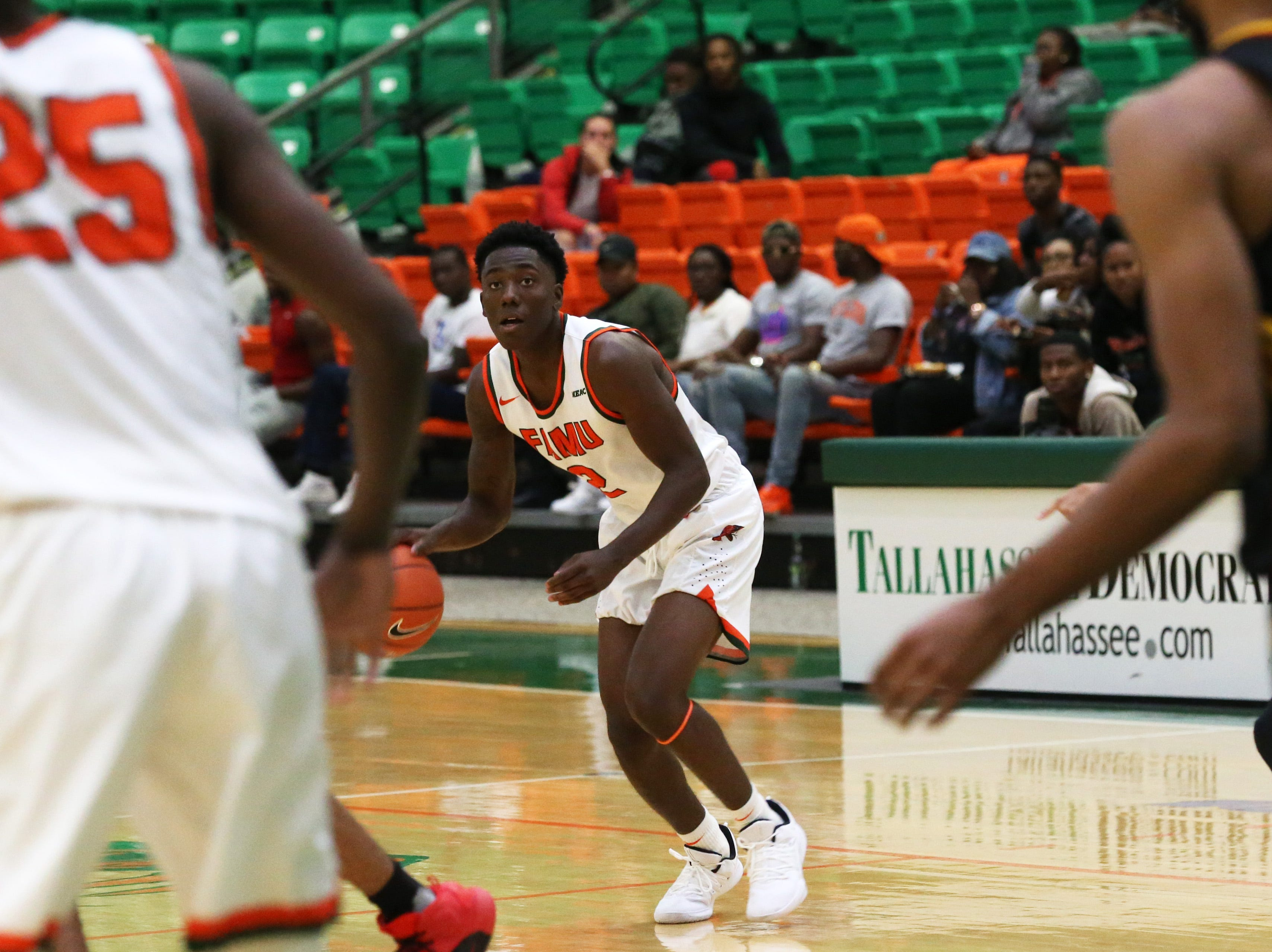 Florida A&M Rattlers guard Kamron Reaves (2) looks at his teammates to make a play as the FAMU Rattlers take on the Tuskegee Golden Tigers in their first home game of the season in the Lawson Center, Saturday, Nov. 10, 2018.