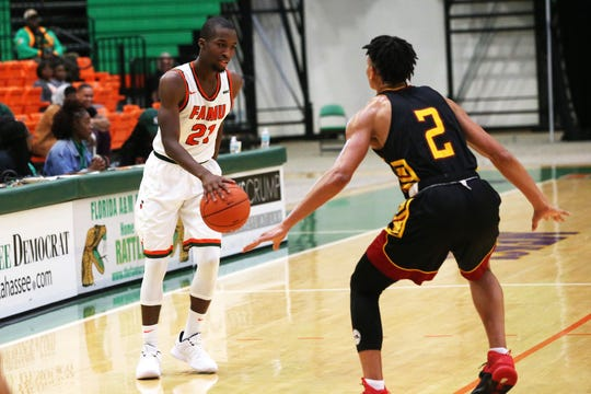 FAMU guard Justin Ravenel (21) sizes up Tuskegee's Kale Morton. Ravenel scored 21 points to lead the Rattlers in a 62-55 win over the Golden Tigers.