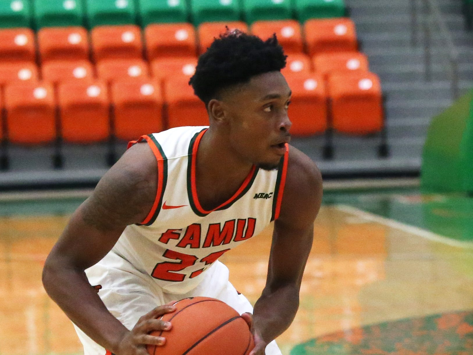 Florida A&M Rattlers forward Bryce Moragne (23) looks to pass as the FAMU Rattlers take on the Tuskegee Golden Tigers in their first home game of the season in the Lawson Center, Saturday, Nov. 10, 2018.
